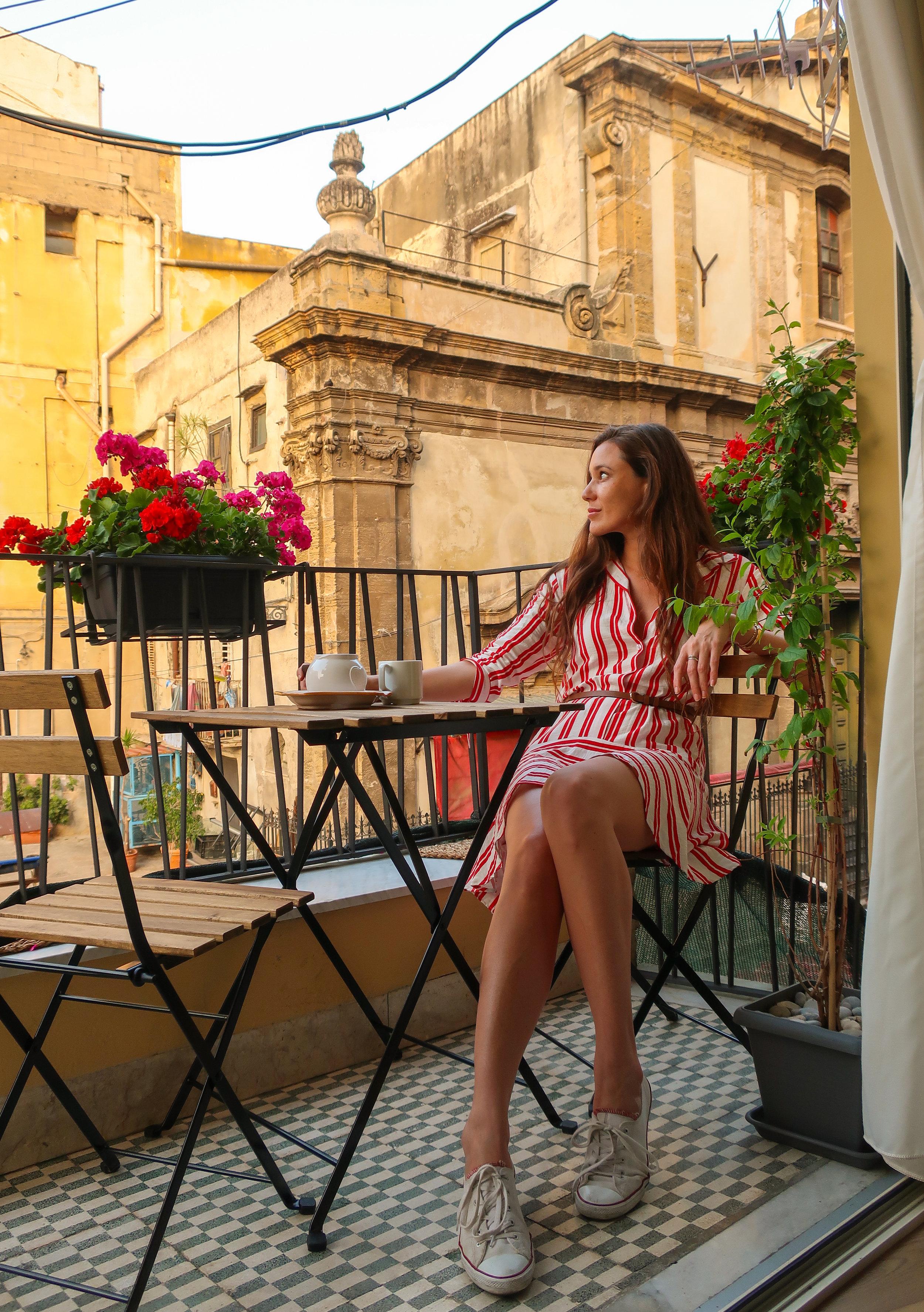 Carina Otero on the Balcony of Punto e Al Capo in Palermo, Sicily