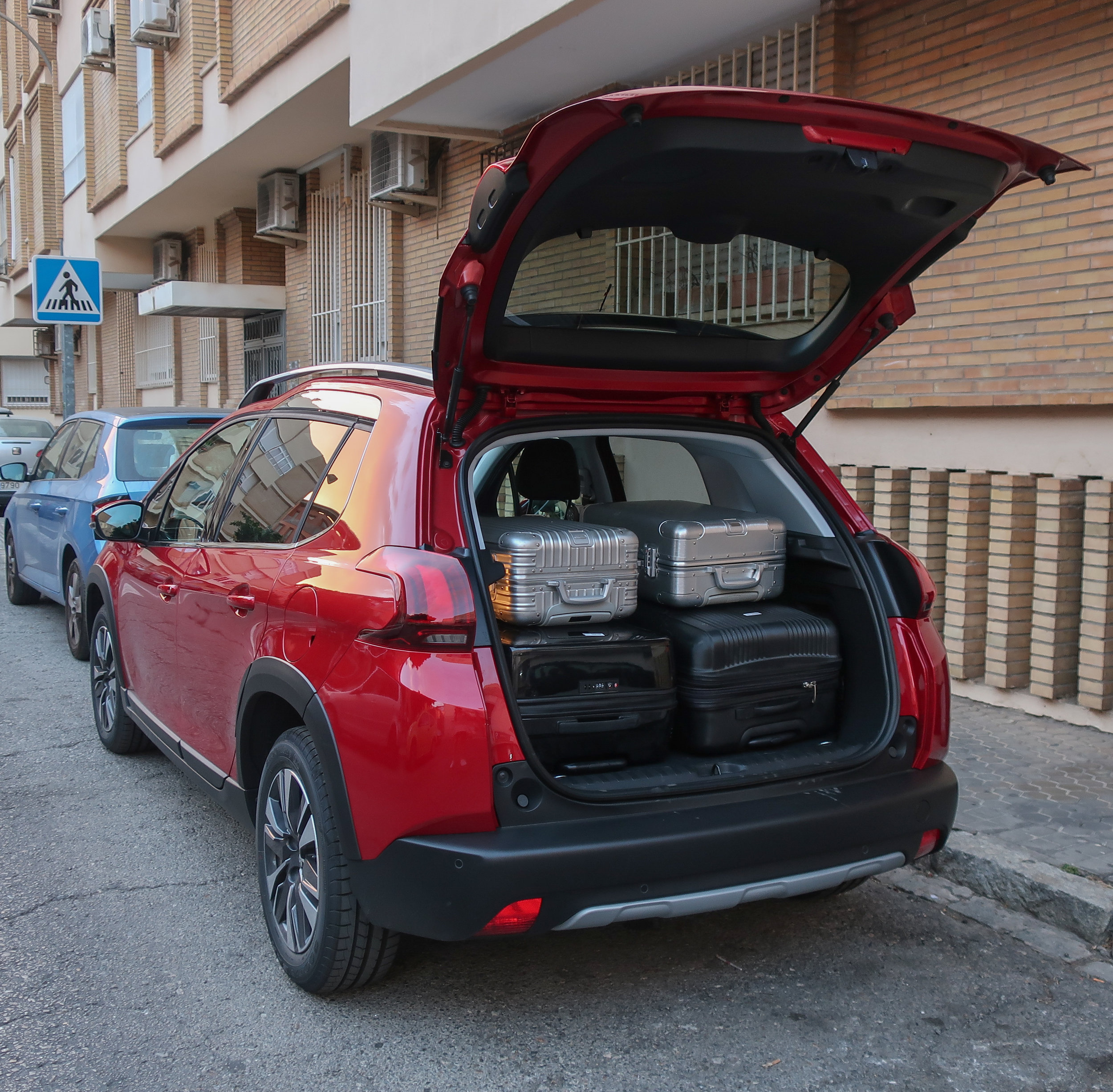 Packed the Peugeot 2008 with two large suitcases and two small suitcases. We folded the backseats down to make more room for our backpacks, photography gear, and extras.