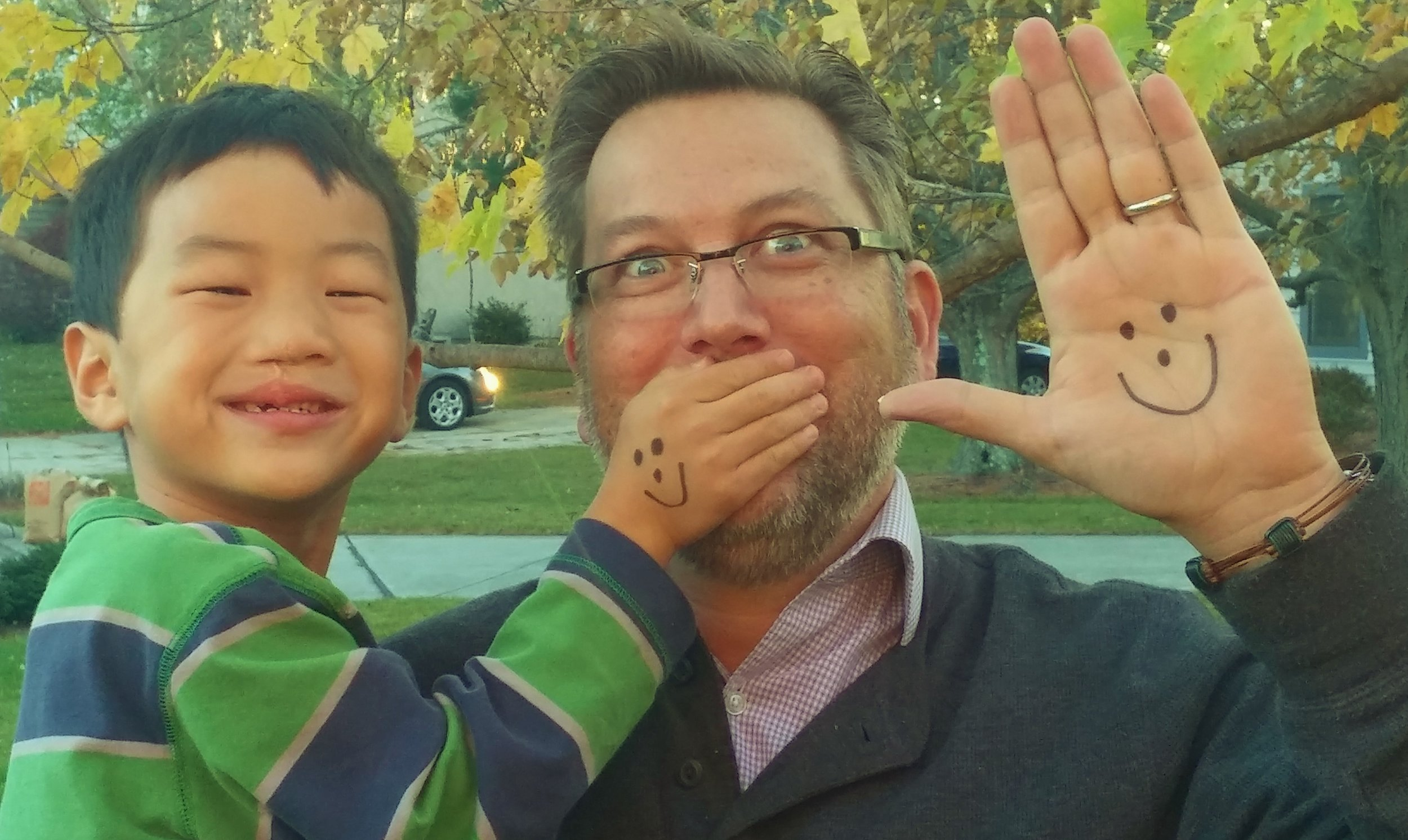 Had I followed my plan, I would've missed out on being Solomon's dad. We're better together, and we're holding up our smiley faces in recognition of World Adoption Day (Nov. 15).