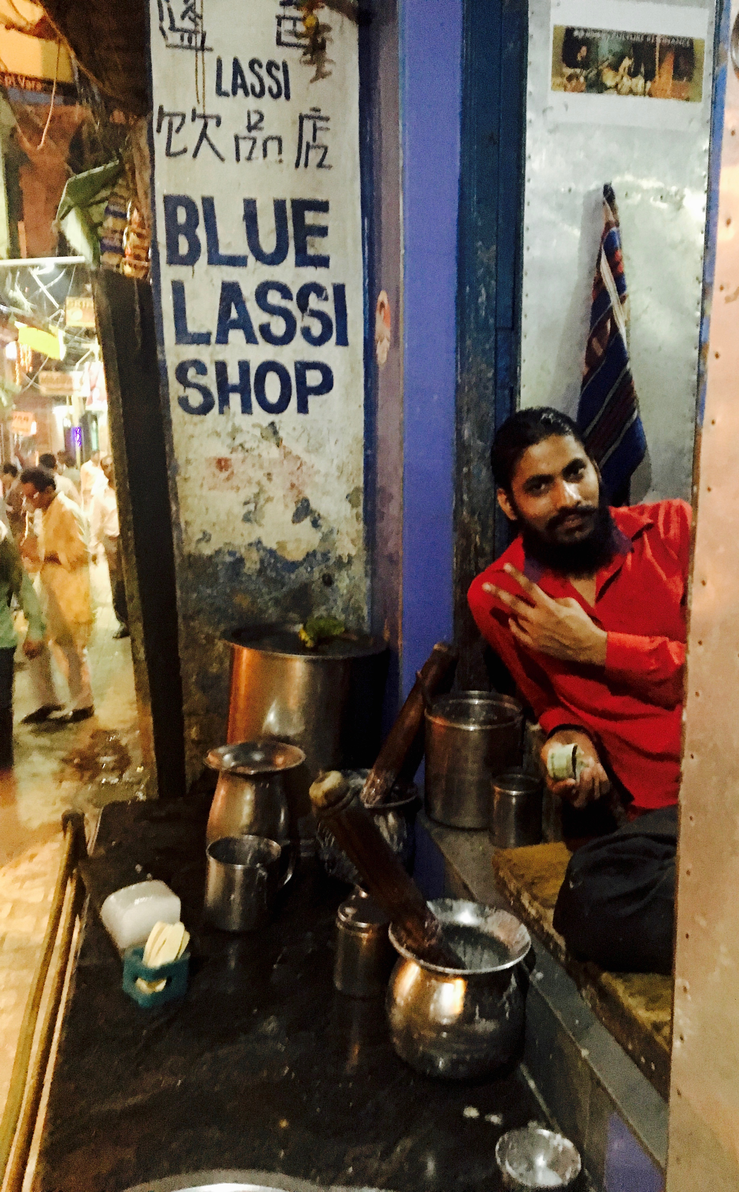 The lassi chef in the flesh and his simple lassi setup.