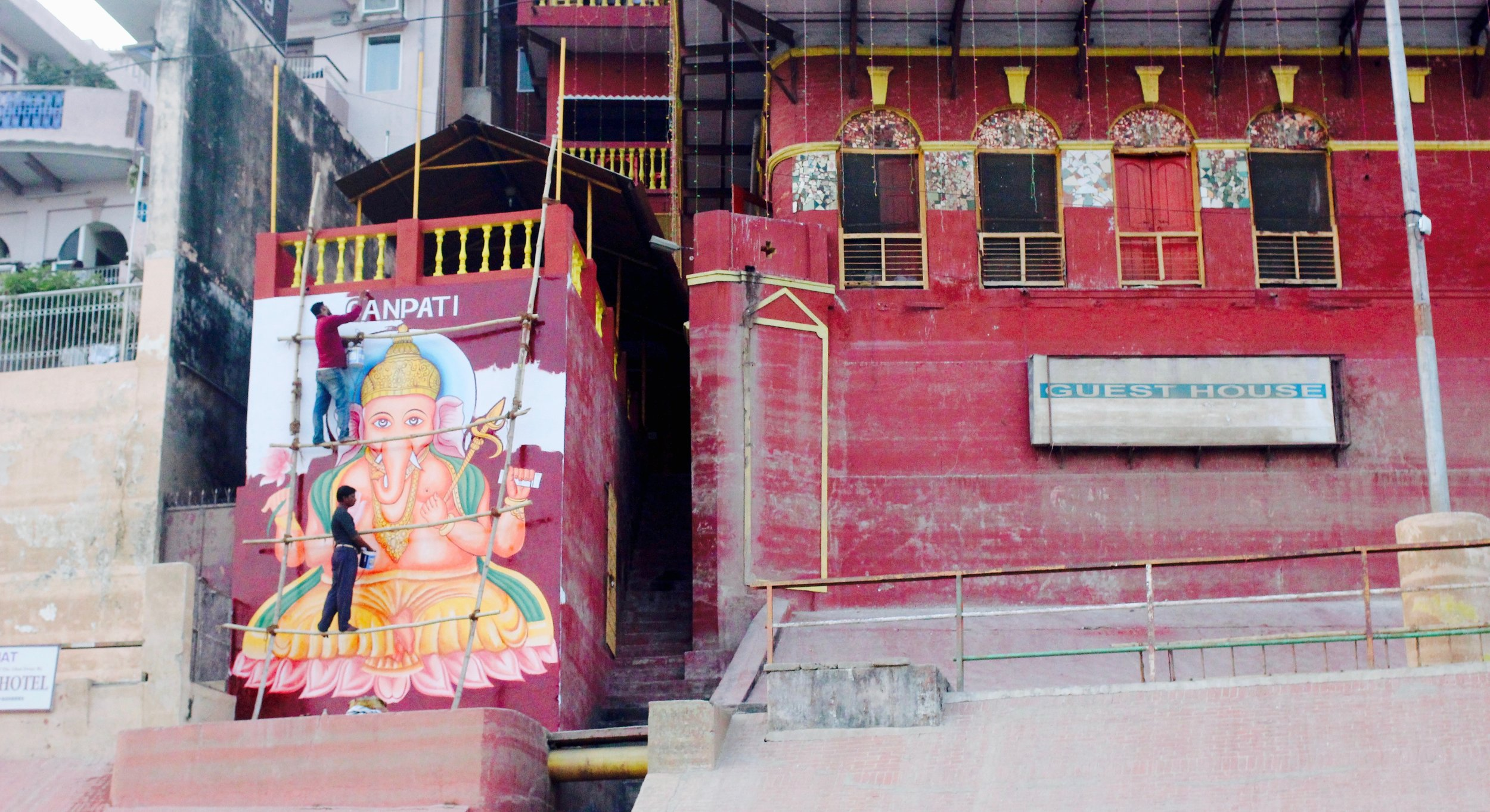 Images of Ganesha everywhere, the Hindi God worshipped on Diwali. They started painting that mural only yesterday.