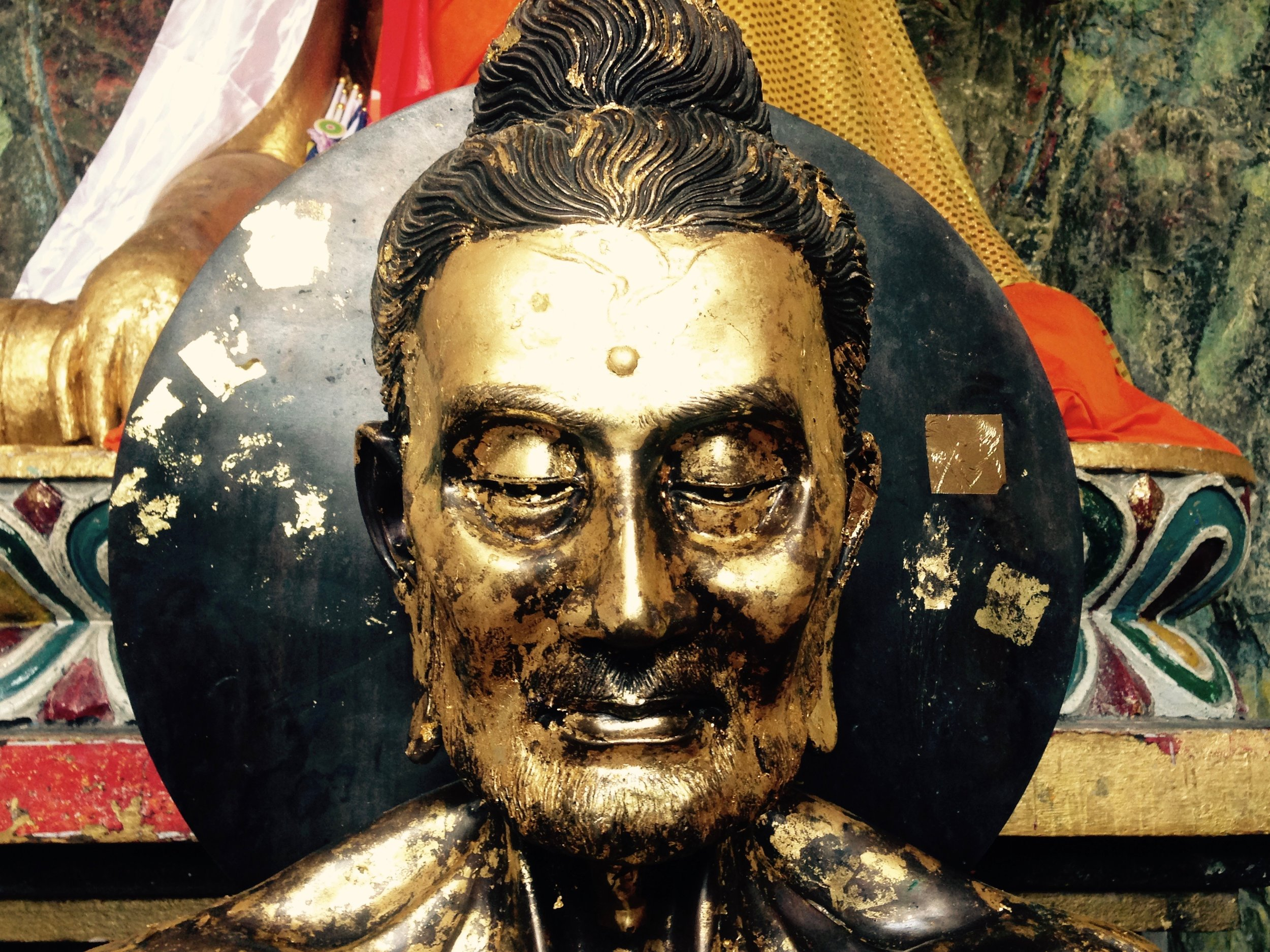 Buddha's emaciated face after 6 years of austere mediation in a dark cave