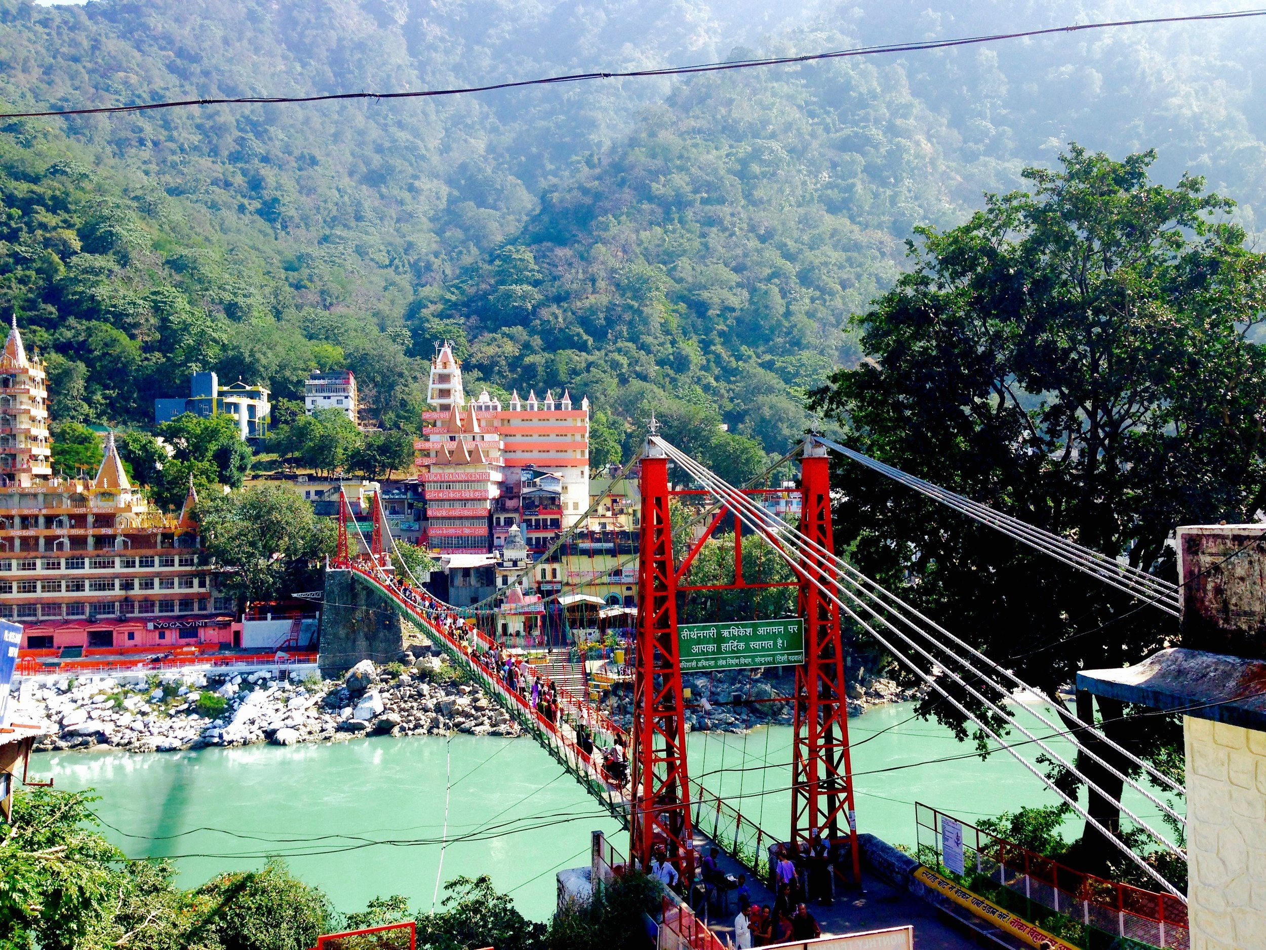 Laxman Jhula Bridge at last! Skinniest little bridge for so much activity -- motorbikes, pedestrians, monkeys, cows, all trying to go about their day. This links over to the other side of the louder, more touristy Rishikesh.