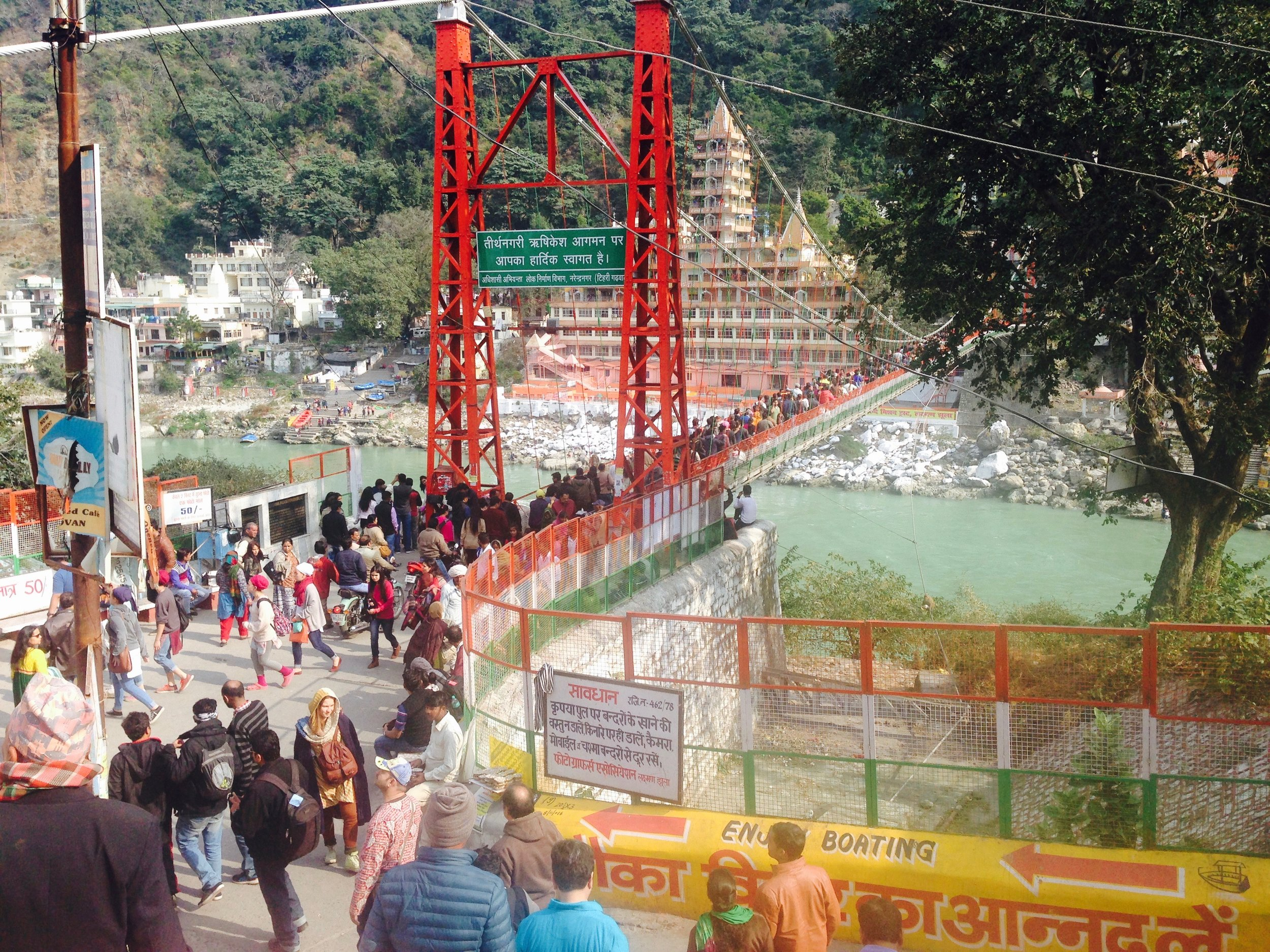 Christmas madness across Laxman Jhula bridge. I stood on the bridge in standstill foot traffic with motorbikes honking from all sides.