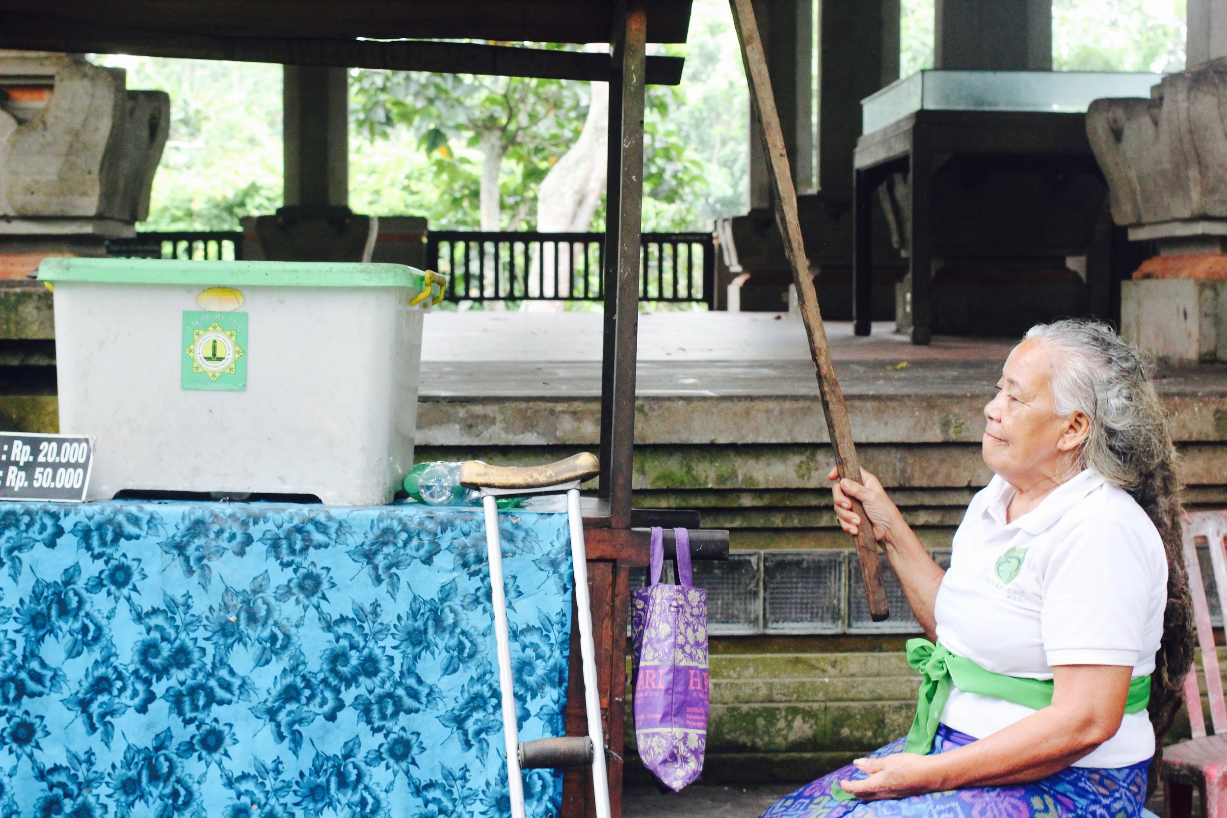 Balinese woman keeps law & order with her monkey stick