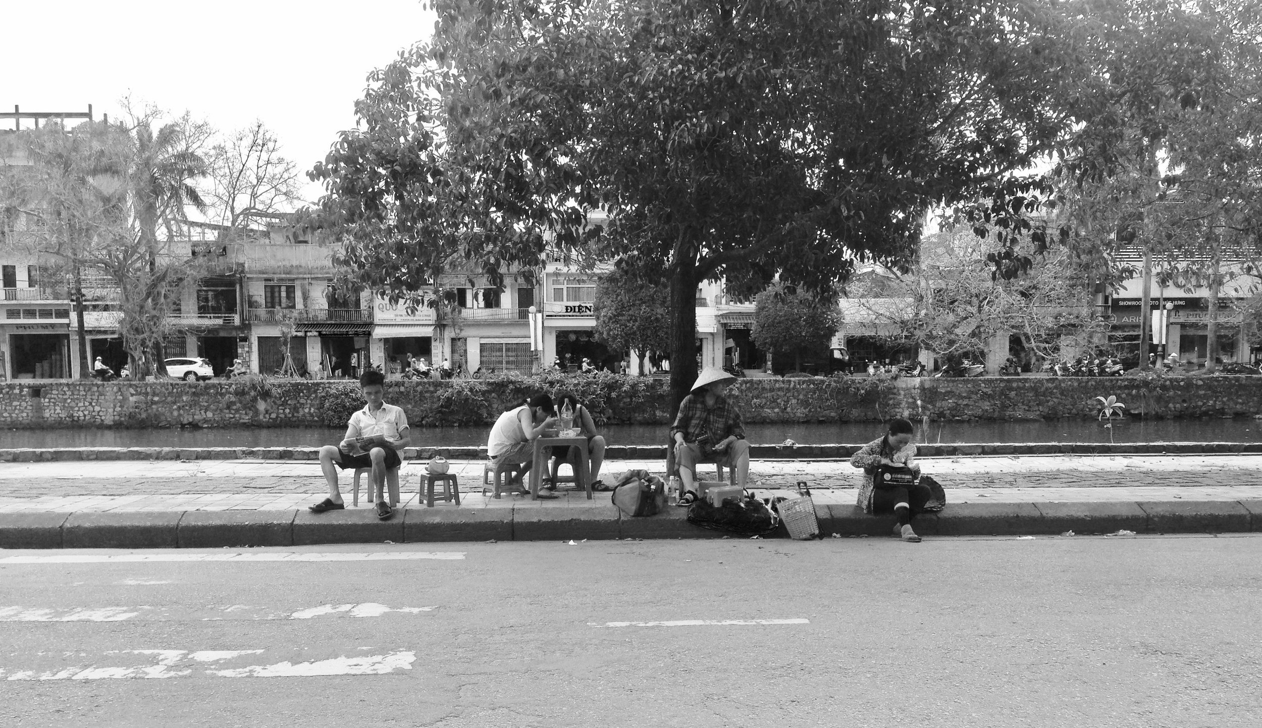 Typical sidewalk action in Hue - little chairs set up for newspaper reading, snacking and traffic watching
