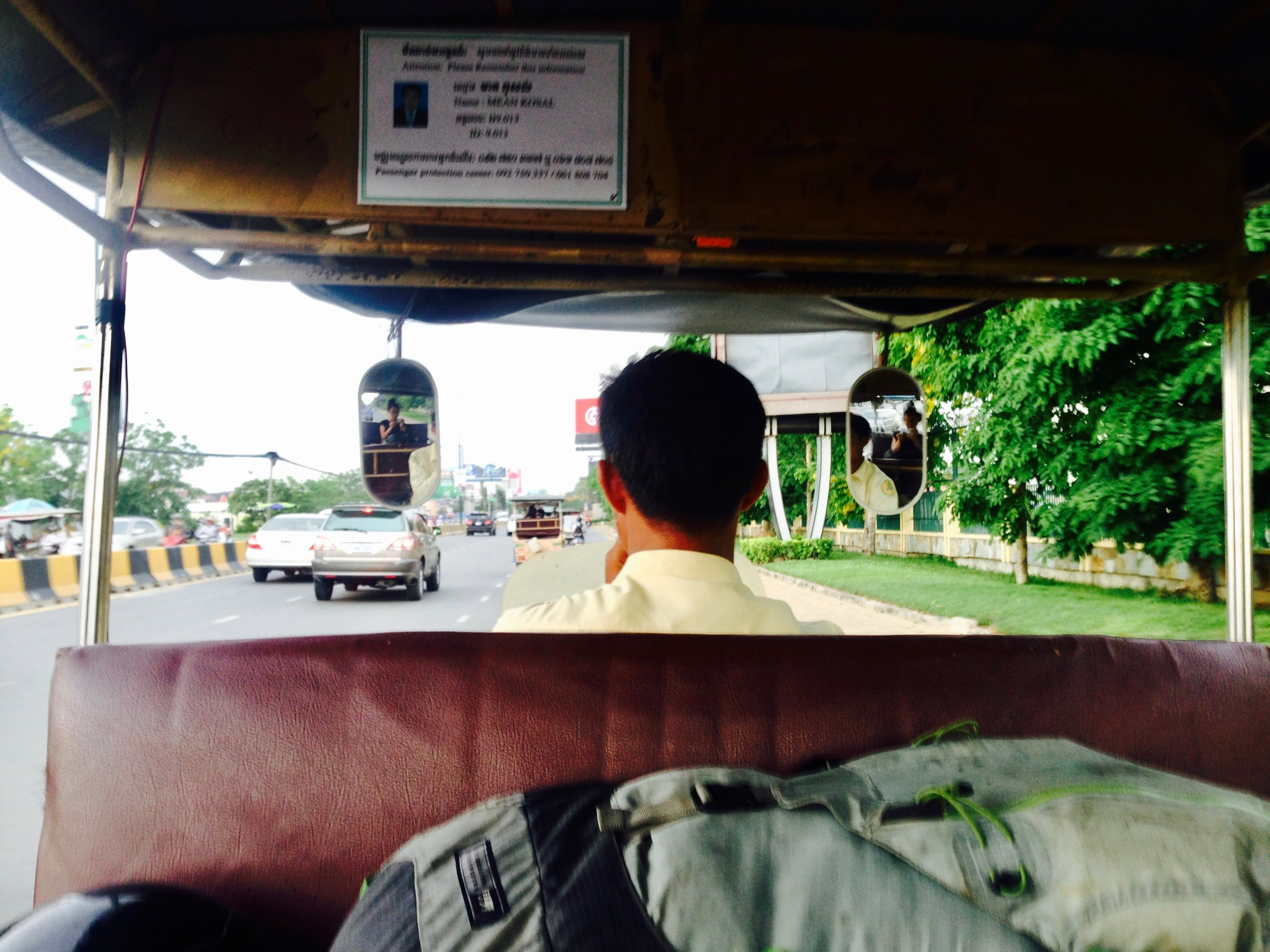 Tuk tucks here have proper curtains on the side (can't see them in this photo)because Cambodian motorbikers are notorious for snatching bags in motion.