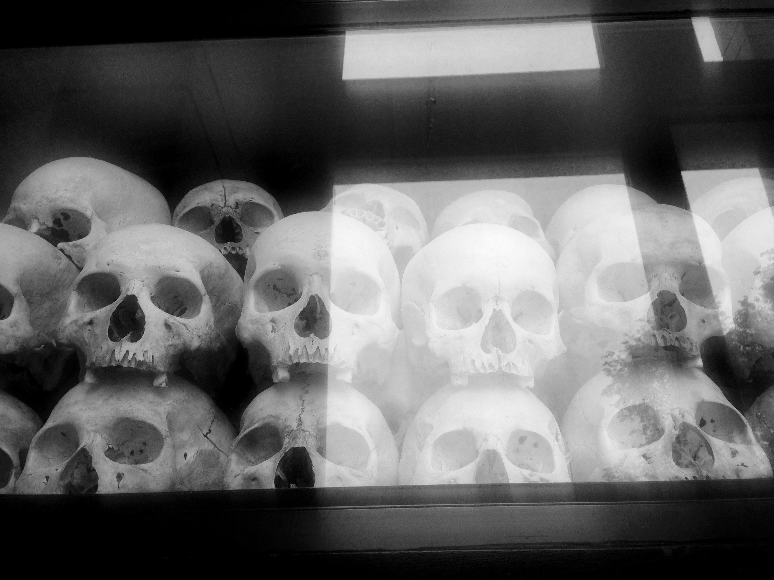 Skull remains that have been preserved at Cambodia's largest Killing Fields. They have been categorized by gender, age, and method of murder. Imagine looking up to eleven stories of skulls, bones and preserved weapons, painting a picture of what unimaginable horror looked like nearly 40 years ago.