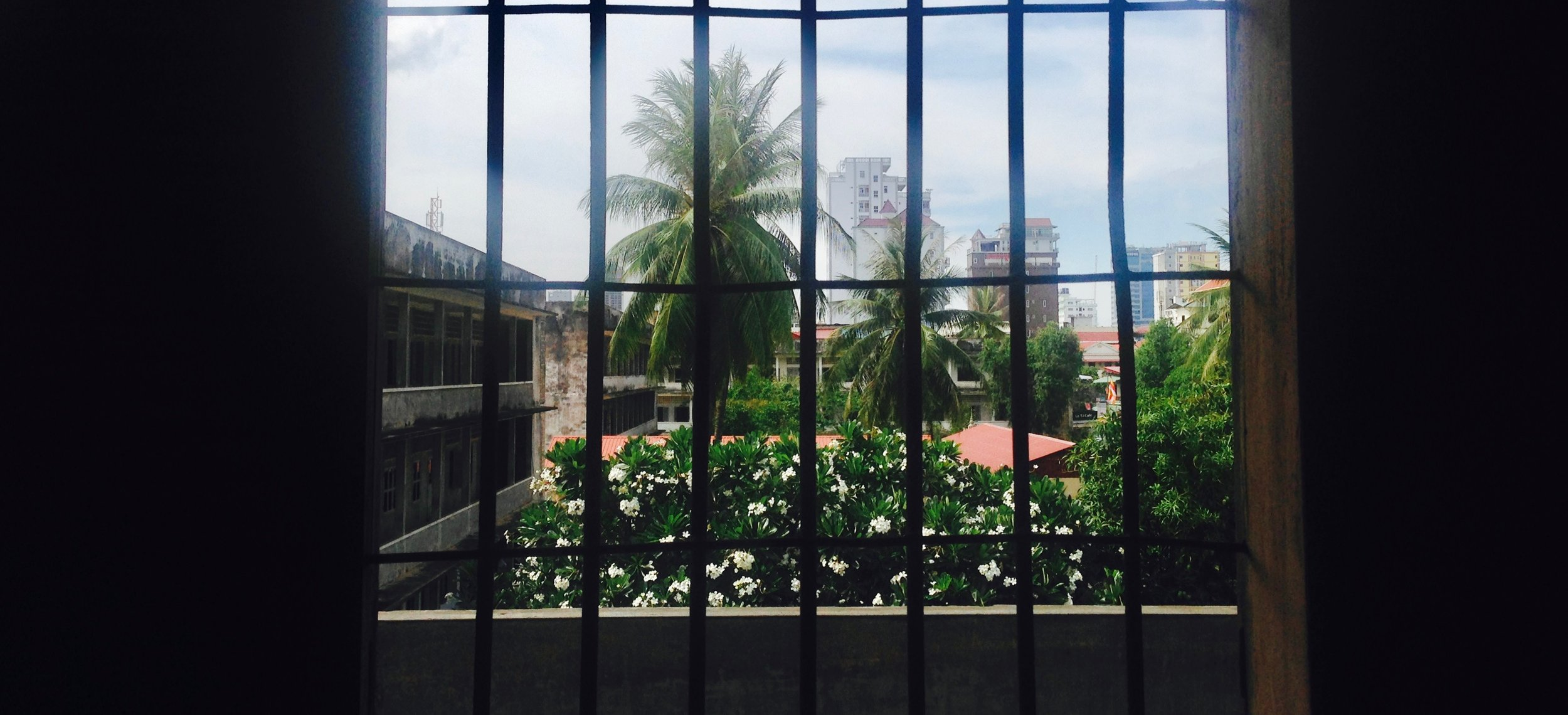 Looking out onto the courtyard from behind bars