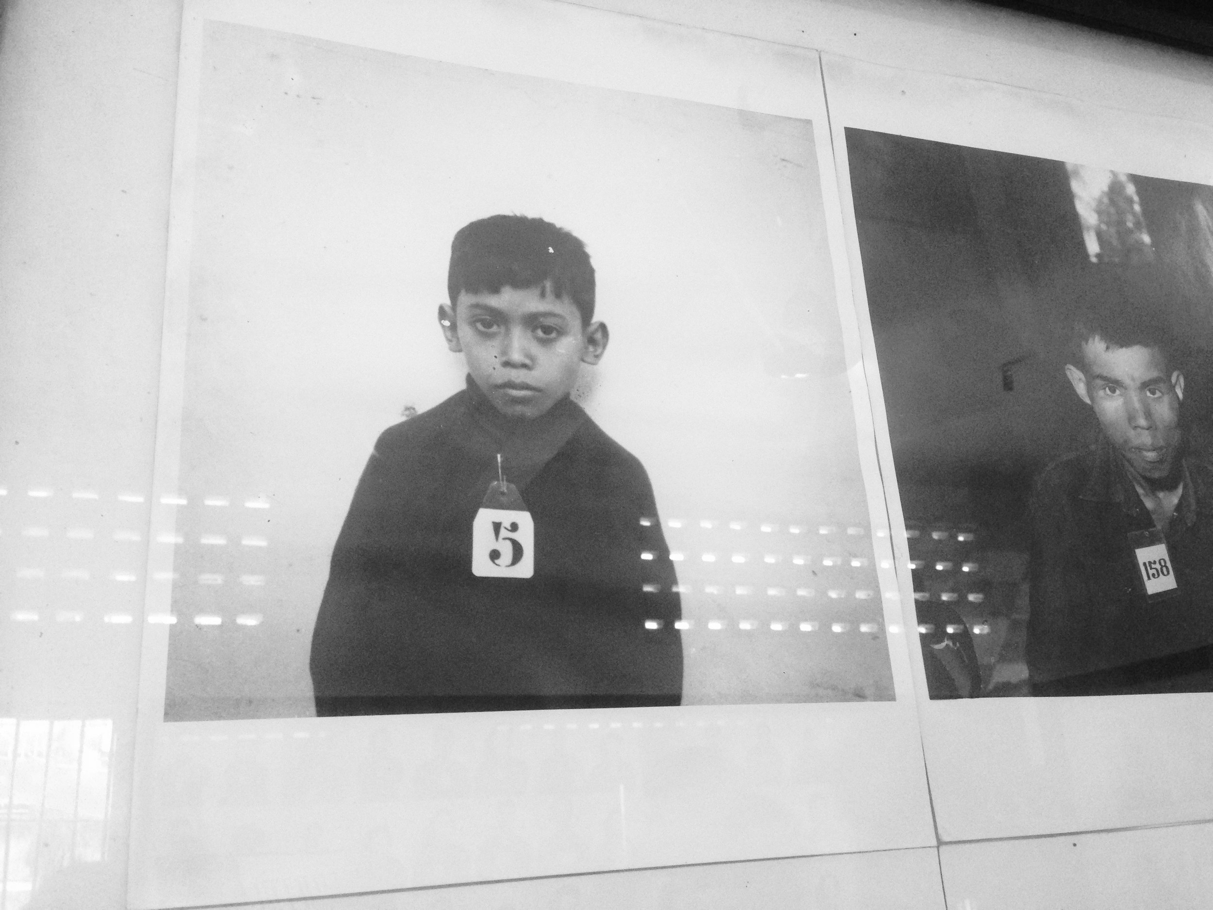 All prisoners are photographed upon arrival at the detention center, including babies, children and mothers.