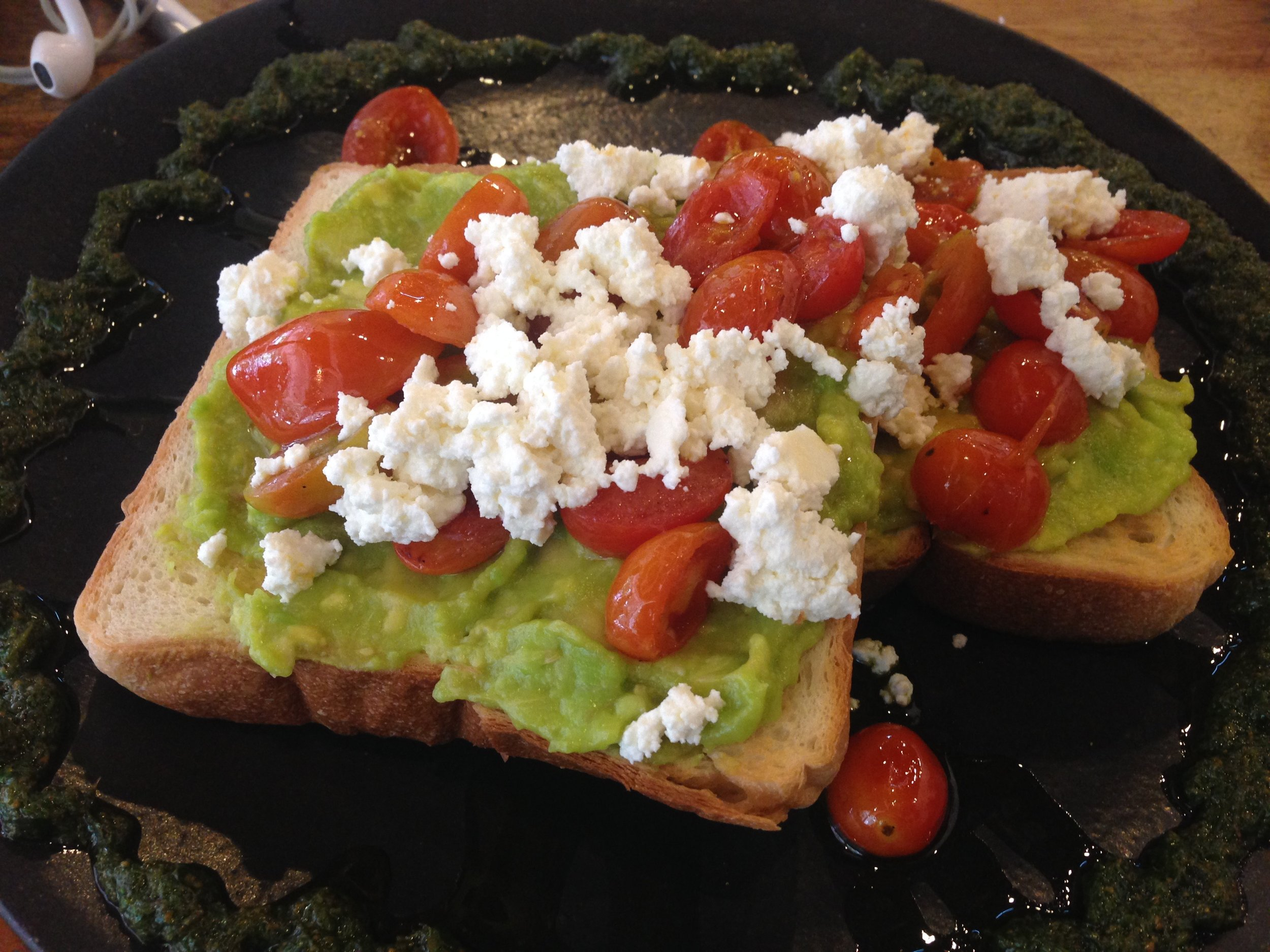 And my all time favorite TAVOCADO! Avocado and tomato smash with crumbled feta on the fluffiest of toast, drizzled with pesto basil cuz whyyyy nottttttt!