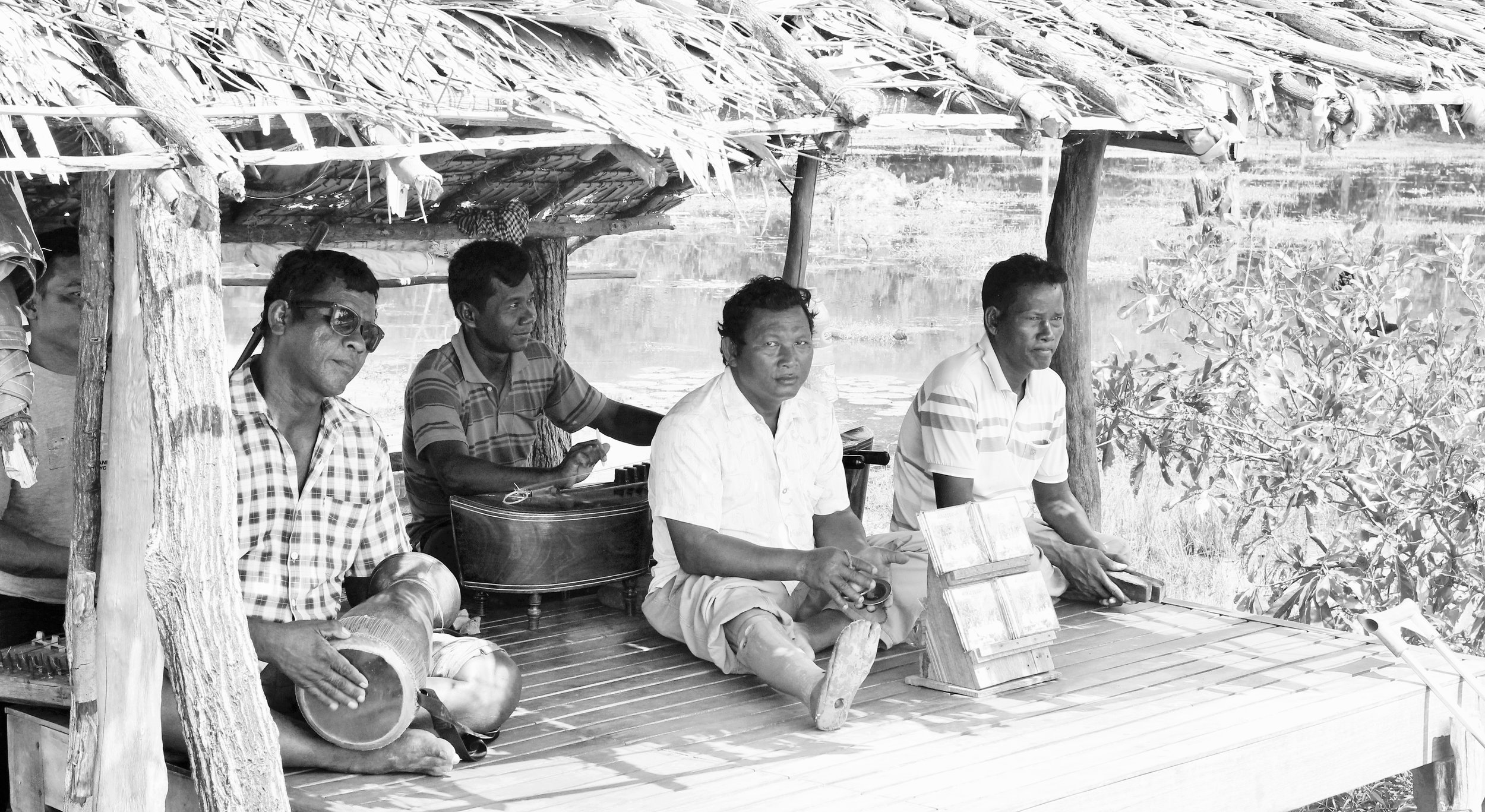 Khmer musicians playing inside temple grounds