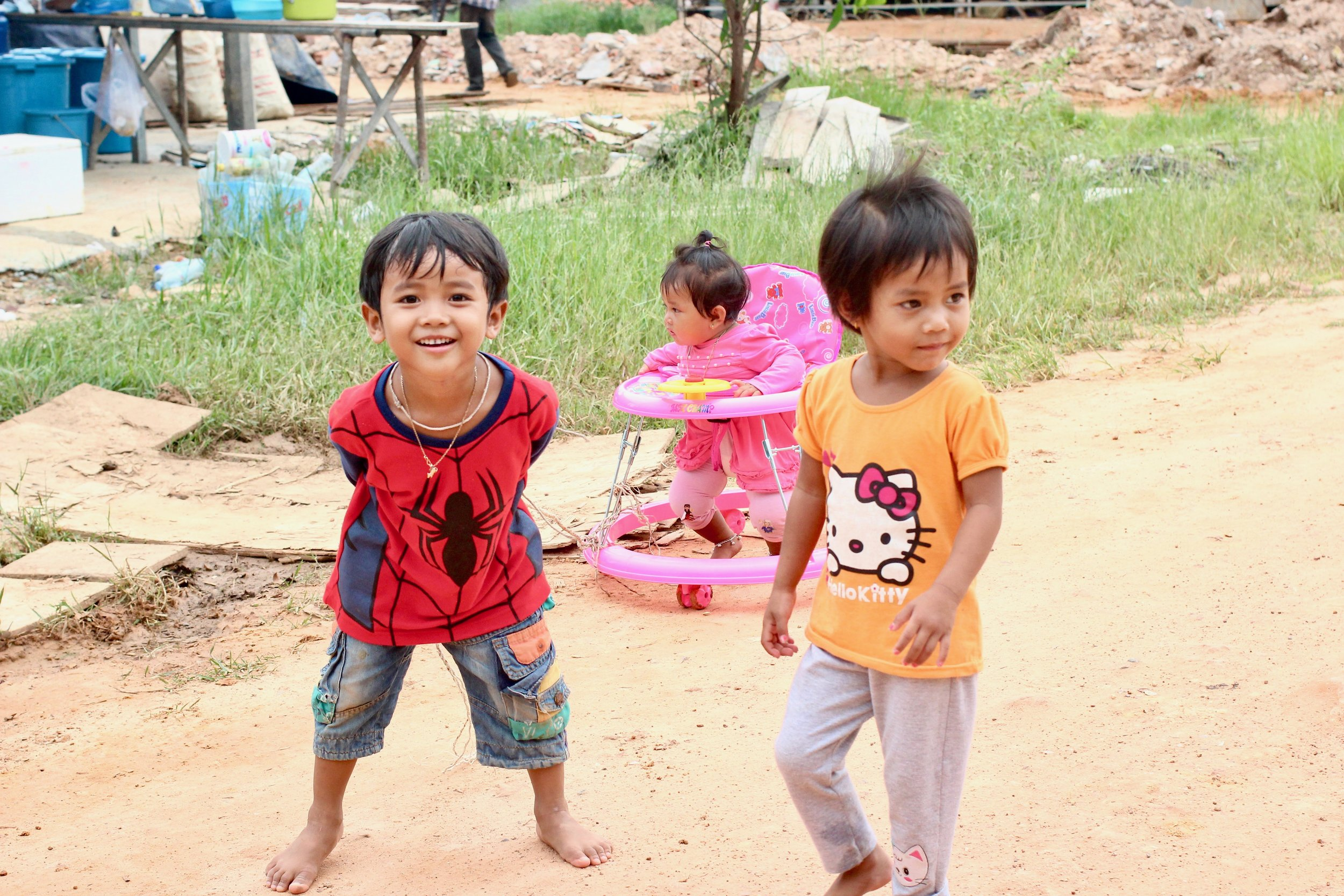 Smiling Cambodian faces as I wander the village. Children = presence always