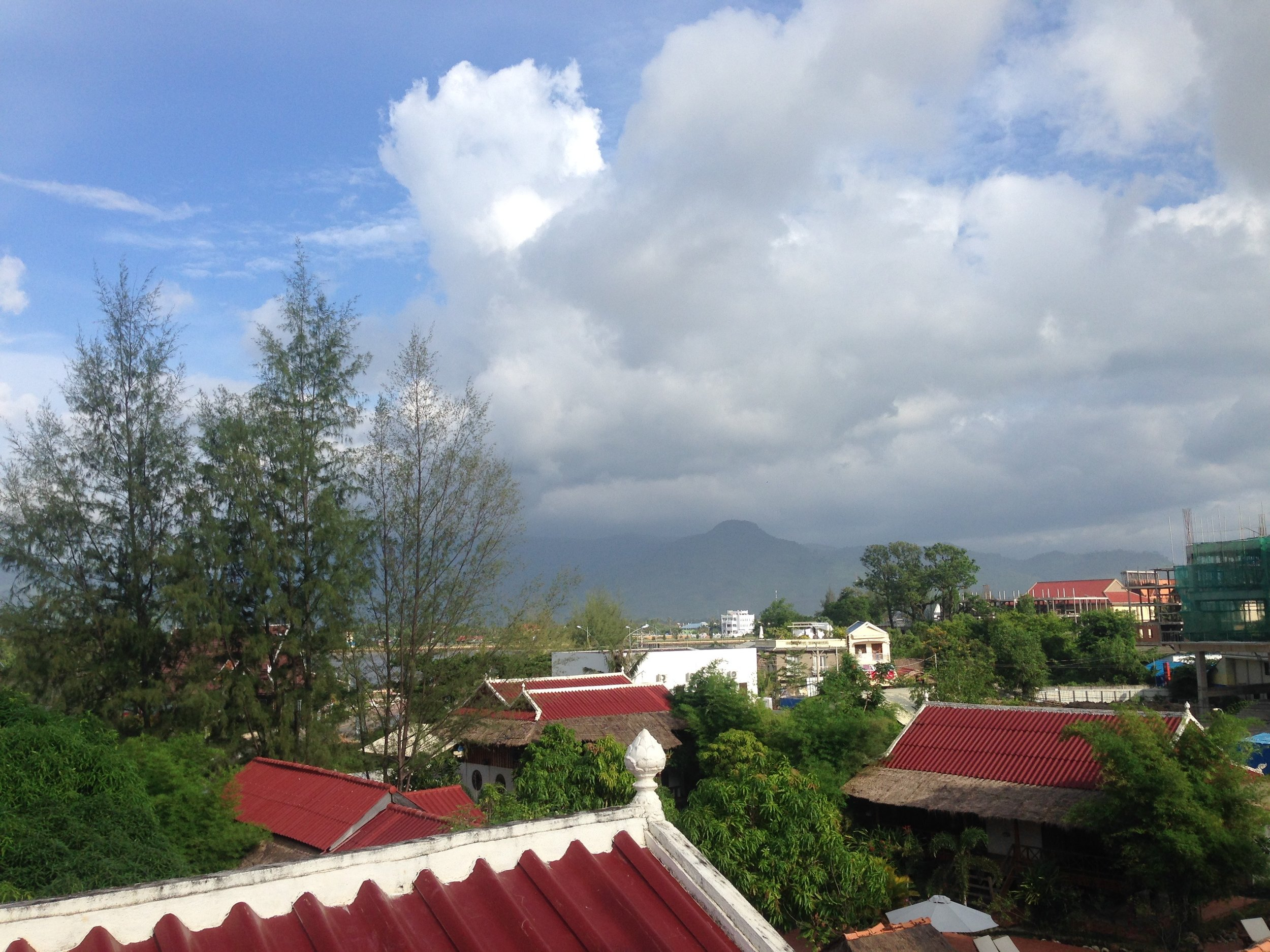 Rooftop vibes, looking at the misty Bokor Mountain