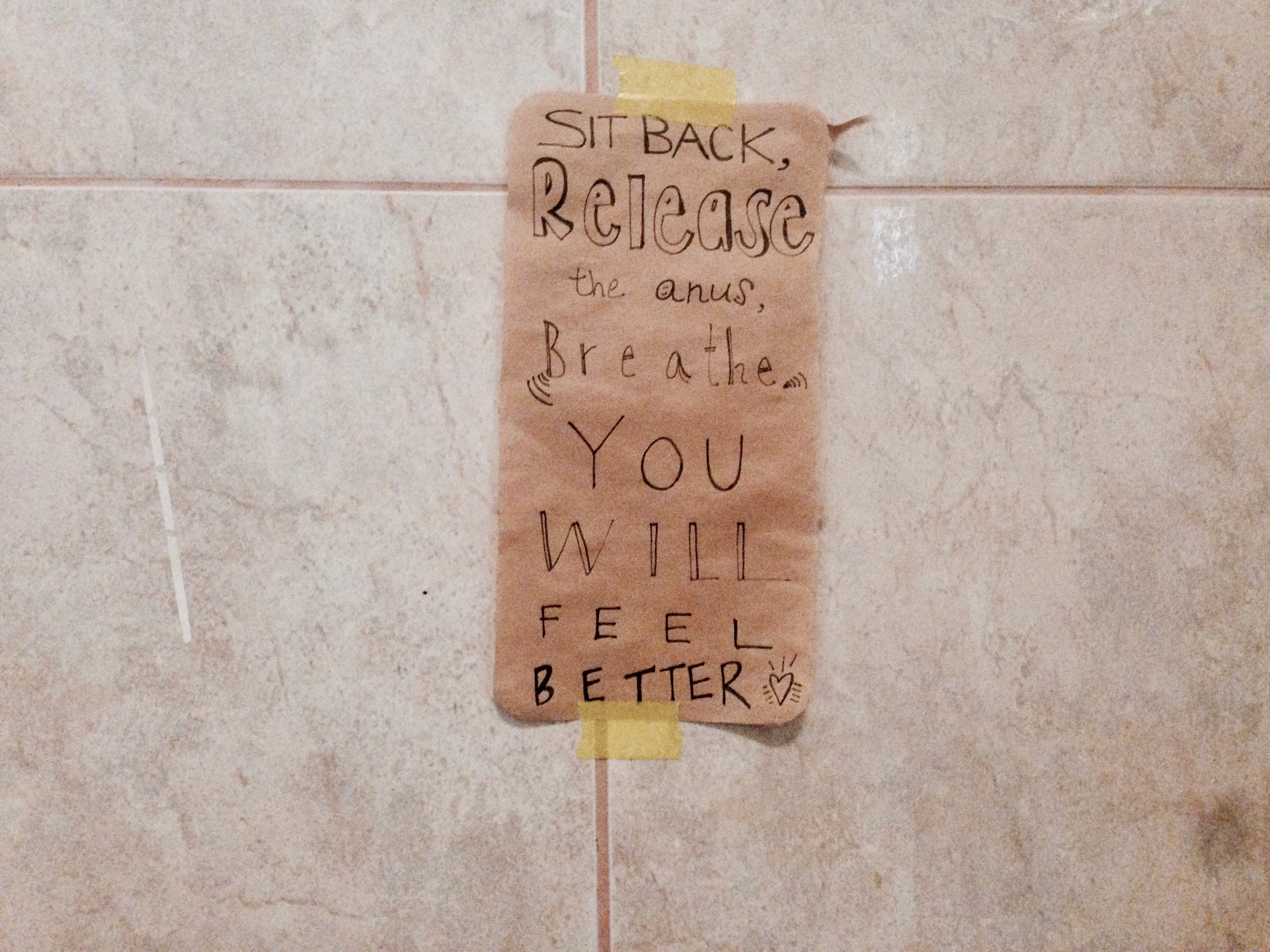 """Word play off of """"squeeze your anus,"""" an ashtanga phrase referring to the """"moola banda lock"""" to help create internal heat for the practice. Love me a good motivational colema sign."""