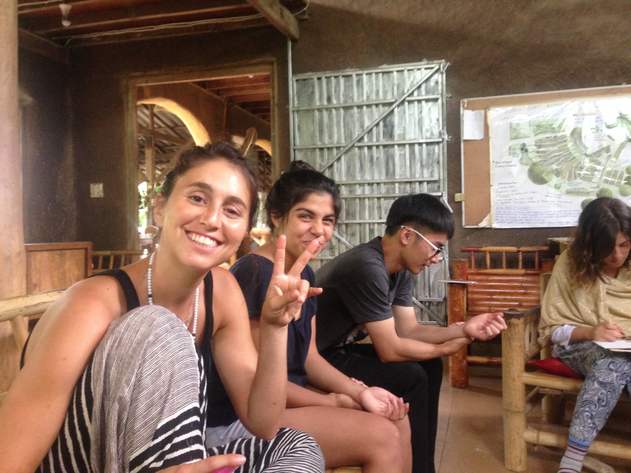 My home slice Martha (from Peru) throwing up peace signs as we get ready for an Ayurvedic workshop in the sala