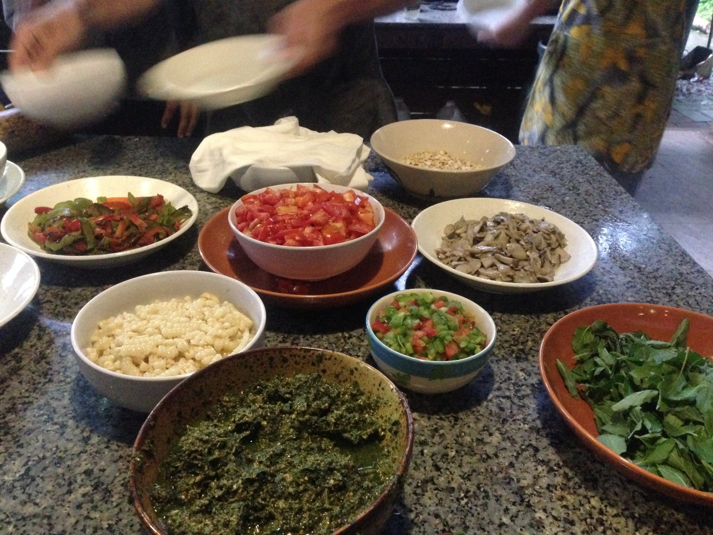Panya pizza toppings, fresh from the farm and village market. On pizza nights, ALL hands are on deck. There are never too many cooks in a kitchen at Panya :)