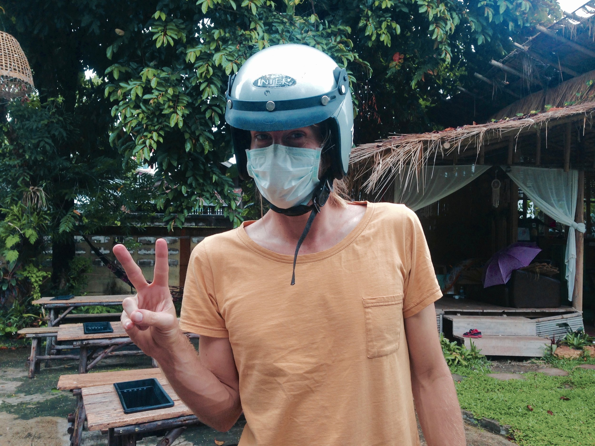 Lesson for us all: when motorbiking on a highway from Chiang Rai to Myanmar, and back, always ALWAYS wear protection. And throw up them peace signs for added coolness.