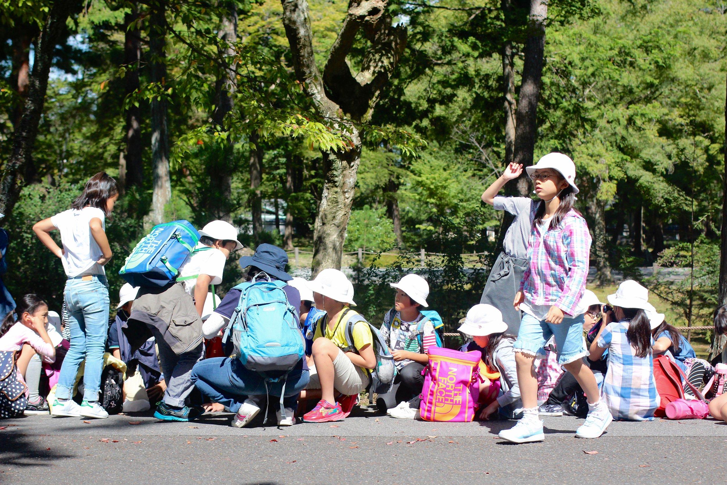 Japanese schoolkids in their matching fishermen hat