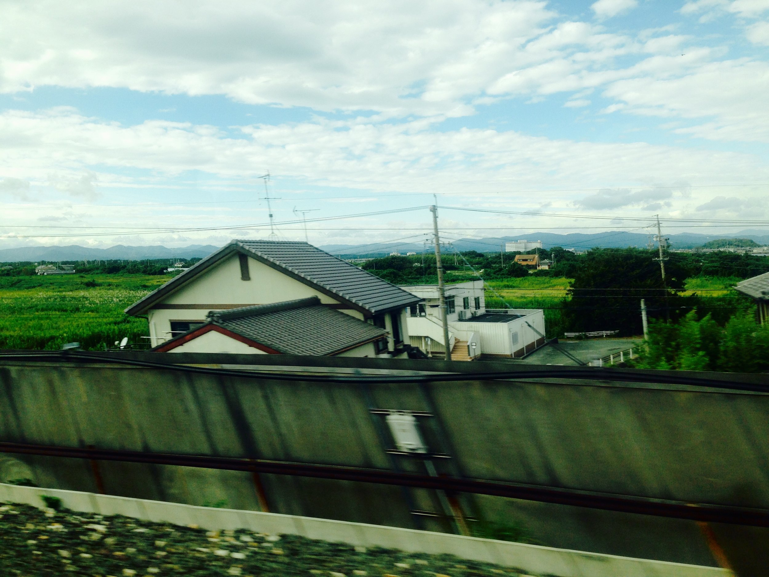 Pocky in my mouth Riding on a bullet train Coming, Kyoto  #haikuforyou