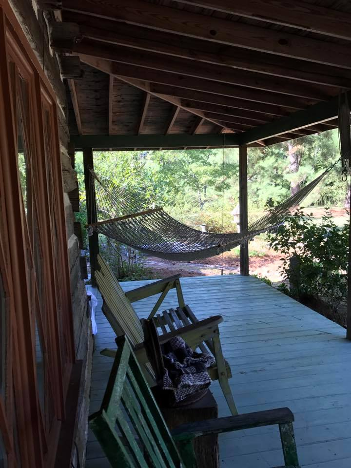 part of your private front porch with a hammock for you to enjoy and listen to the sounds of the horses grazing