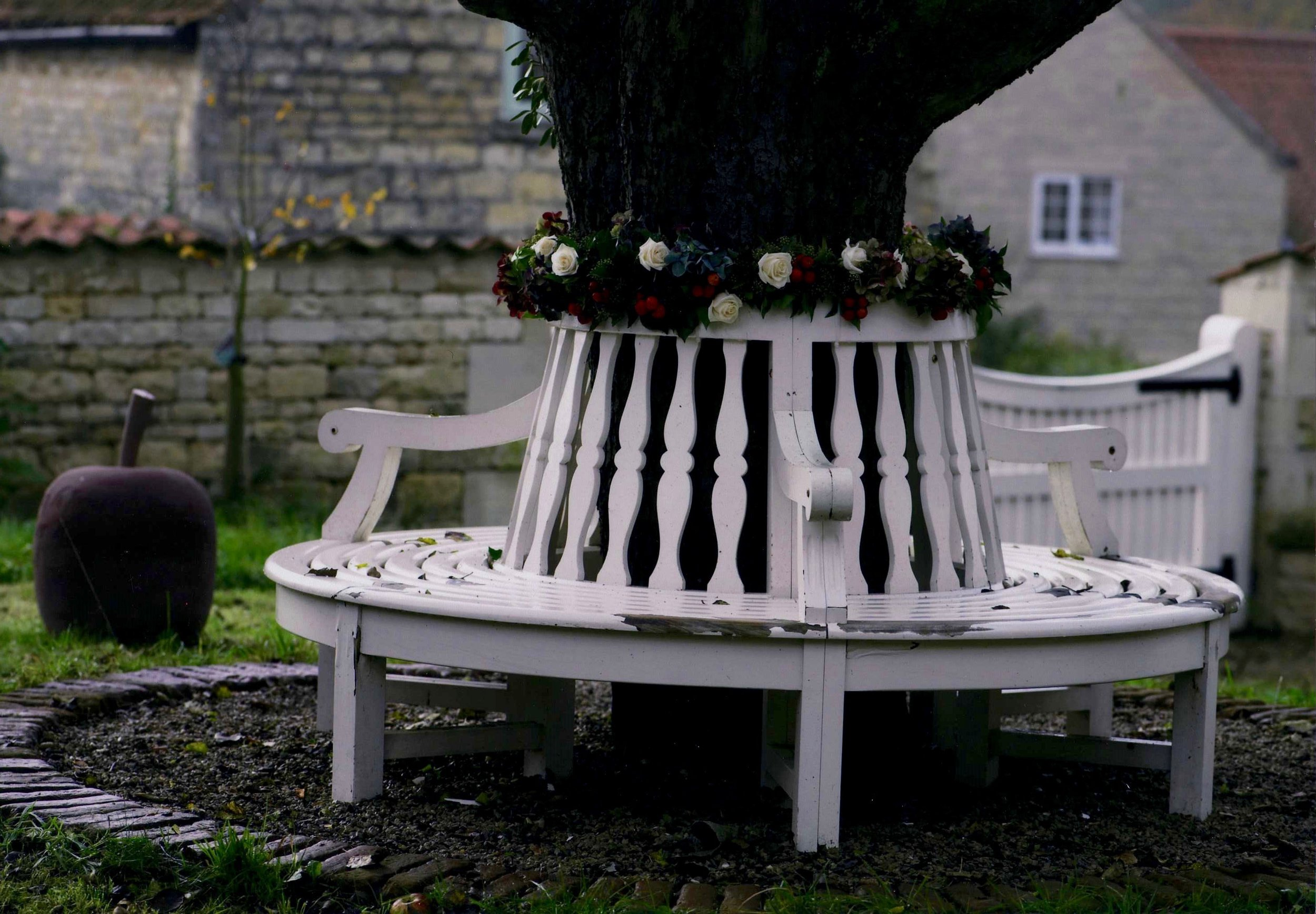 The bench around the apple tree, Newton's Chapel, England.