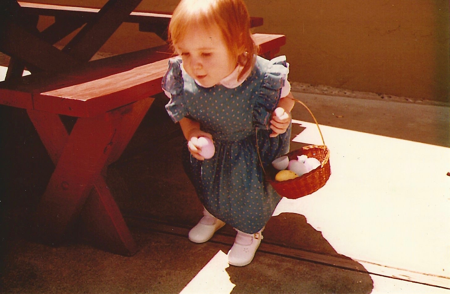 Kate at 18-months-old, on the hunt for Easter eggs.