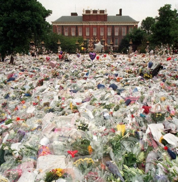 Floral tributes and balloons laid in the gardens of Kensington Palace.