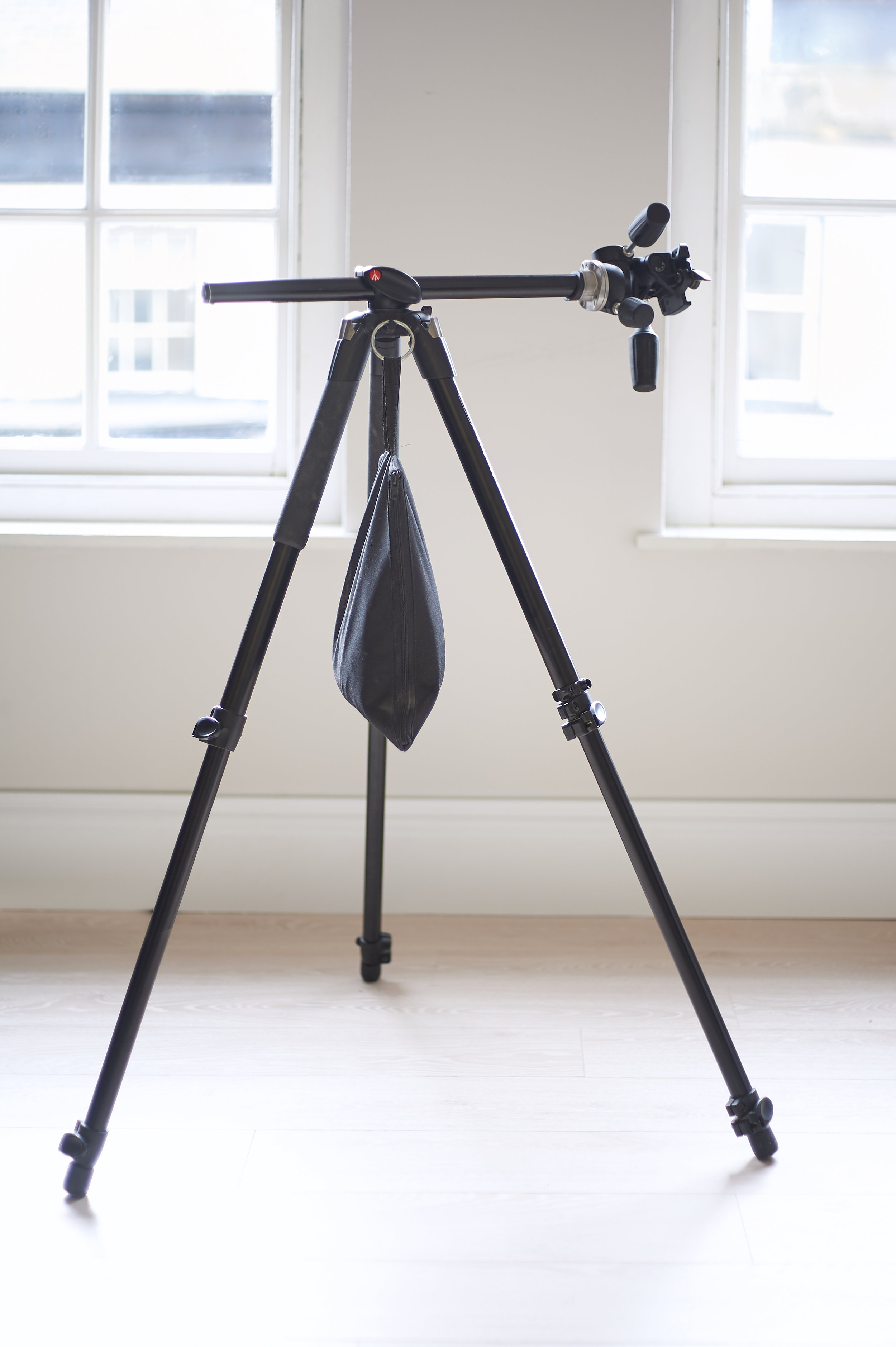 My own Manfrotto Tripod, shown with  horizontal central column, and a  sandbag attached for additional stability.