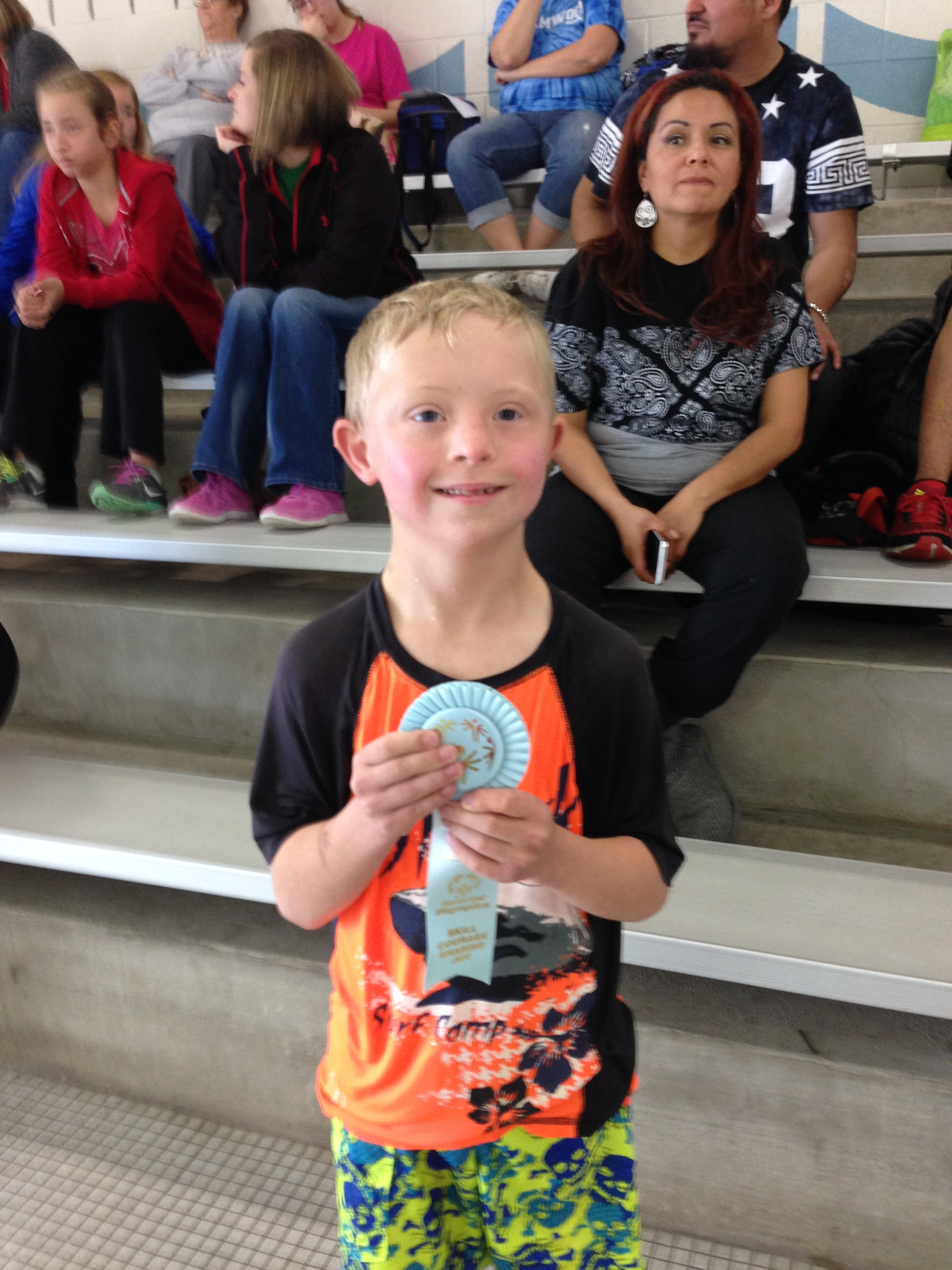 """Aiden's 1st meet he competed in. He found the courage to jump in and swim in front of many people! He was very """"Brave in his Attempt""""."""