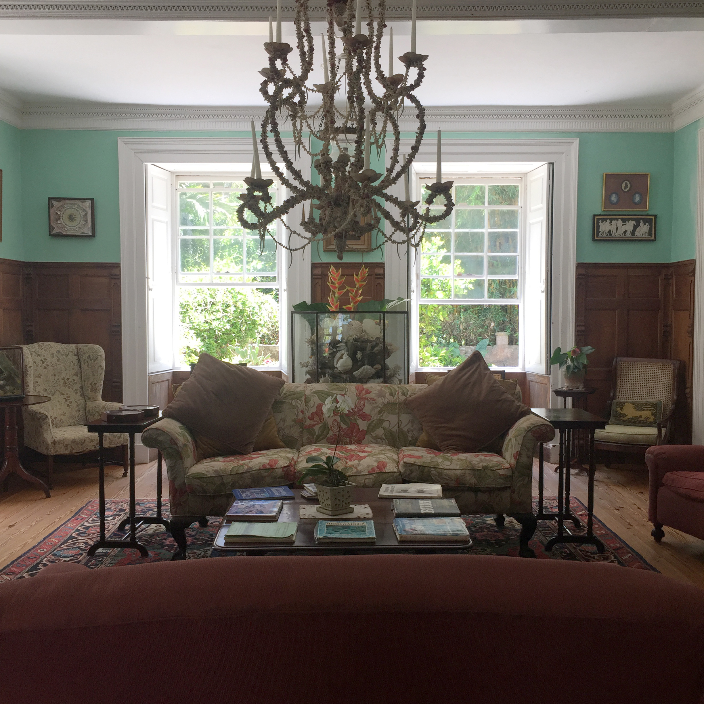Tiffany blue drawing room with seashell chandelier.