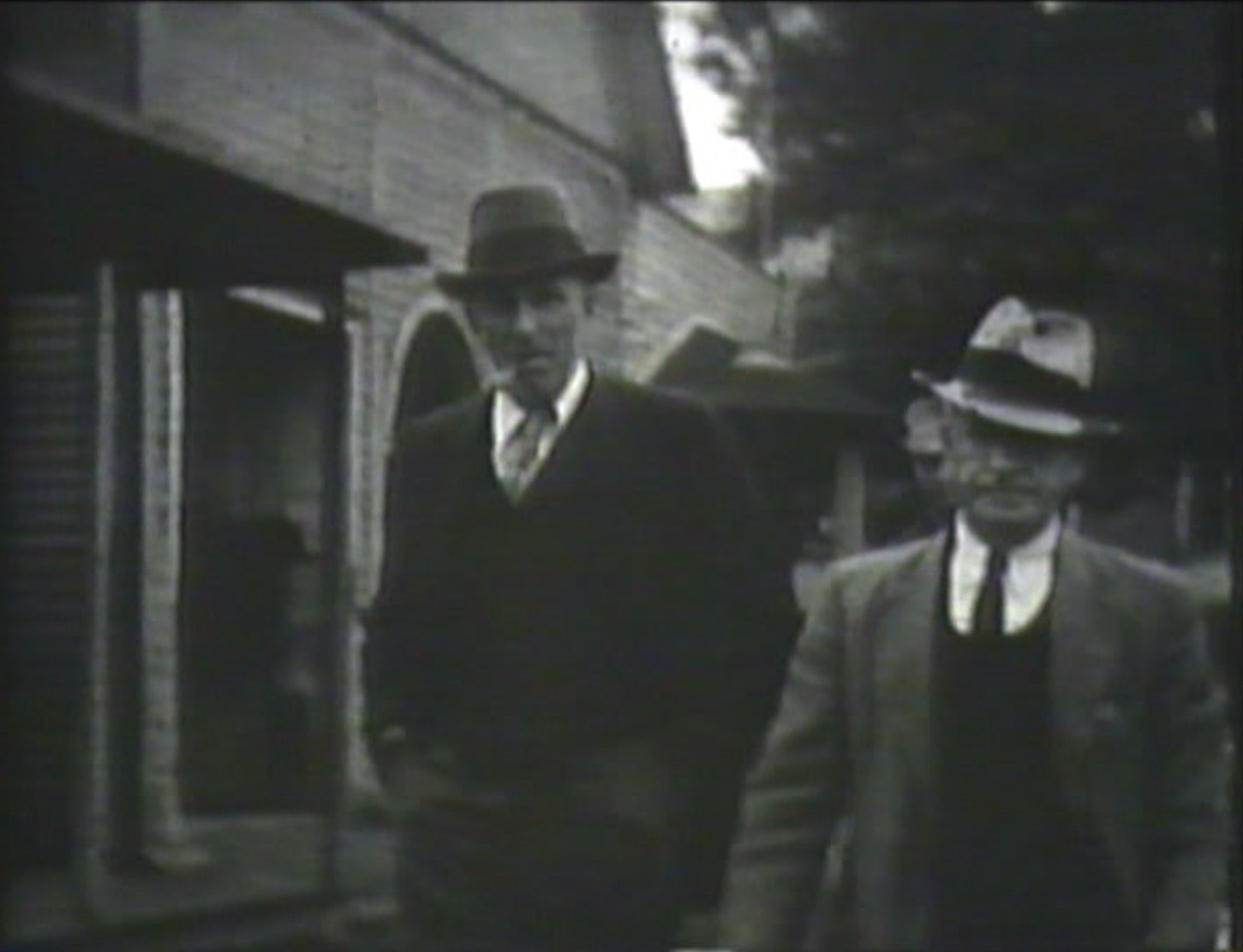 Screenshot from the 1936 H. Lee Waters Film of Boone and Cove Creek. We're still trying to identify that building behind these gentlemen, which we think was in Boone. Any idea what this is? Email us and let us know!