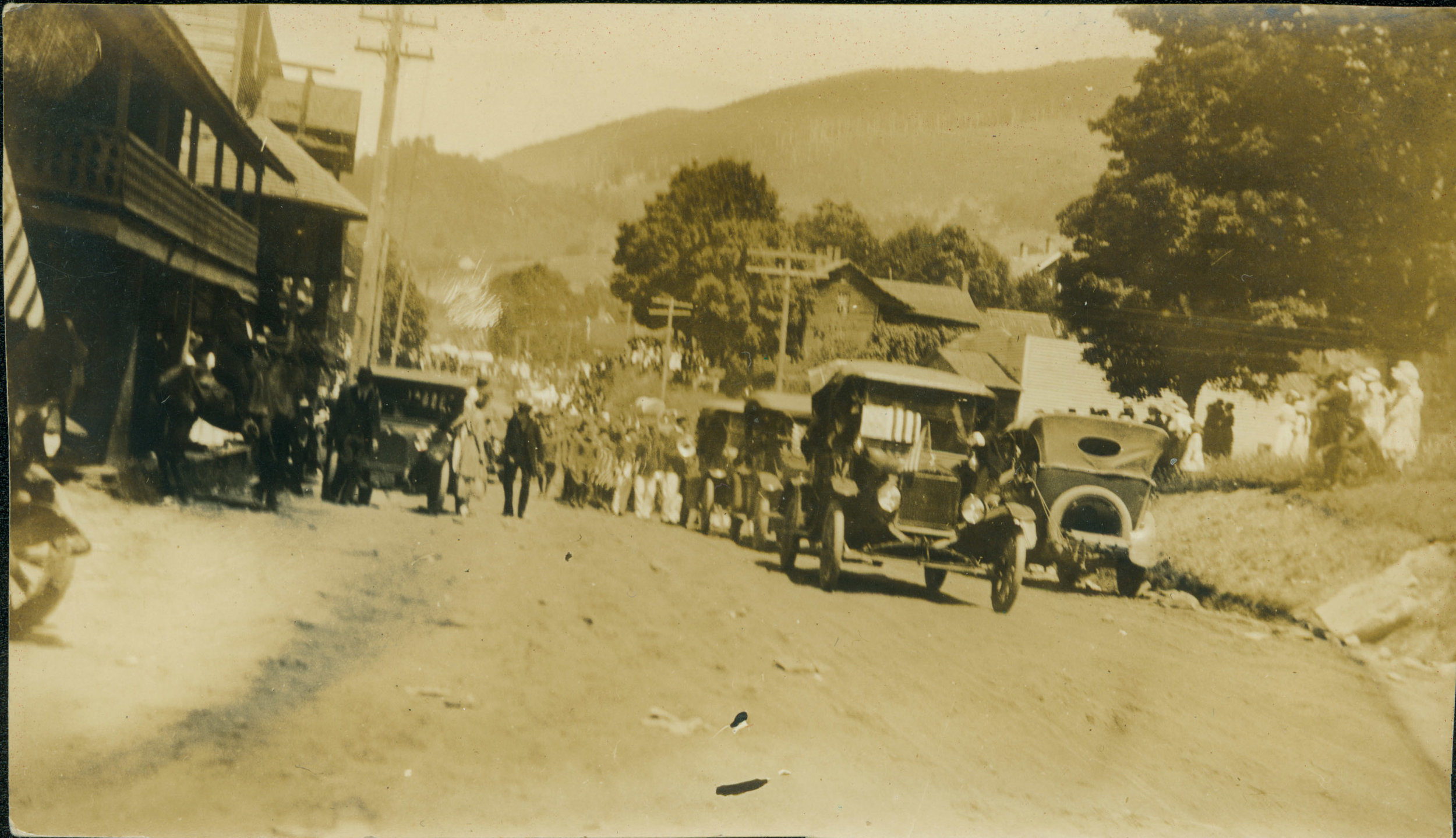"""West King Street (then known as """"Main Street""""), looking west, during the July 4, 1919, parade. The trees at the Jones House are on the far right, which the J. D. """"Crack"""" and Emma Councill House can be seen at right center, near the first telephone pole on the right. Image courtesy of the H. L. and Gladys Coffey Collection, Digital Watauga Project."""