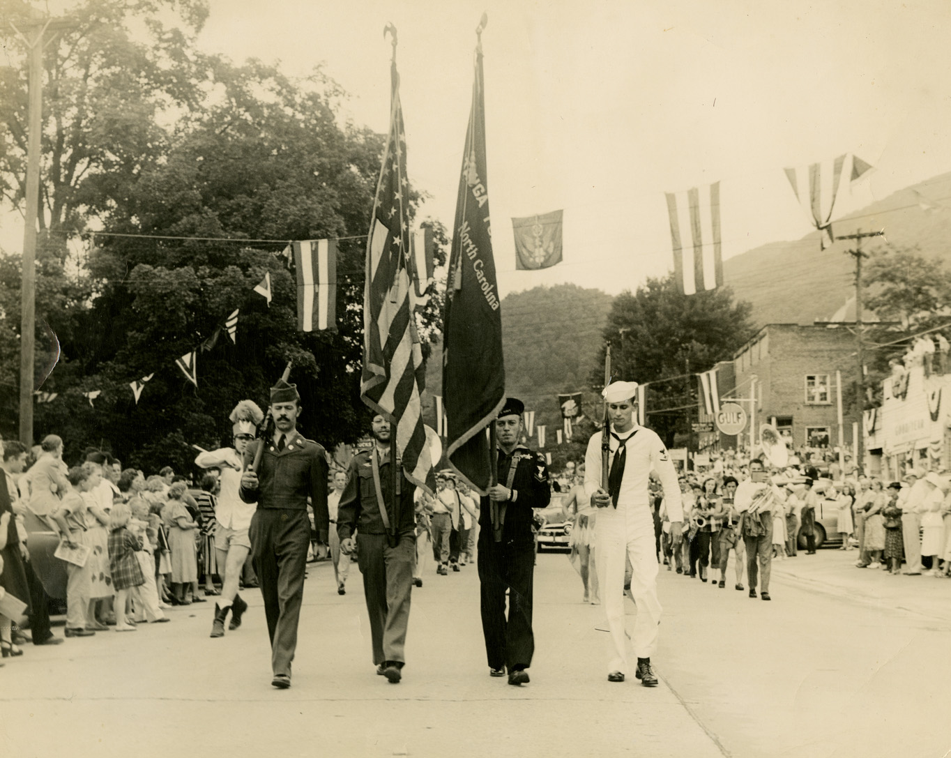 Local photographer Palmer Blair also shot this image of the 1949 Watauga County Centennial Parade color guard marching down West King Street from west to east. Von Hagaman is visible as the second man from the right. The 1875 Watauga County Courthouse with its unusual corner entrance on the first floor is visible at right in the distance. Image courtesy of the Digital Watauga Project, Von and Mickey Hagaman Collection (Von-Hag-1-030).