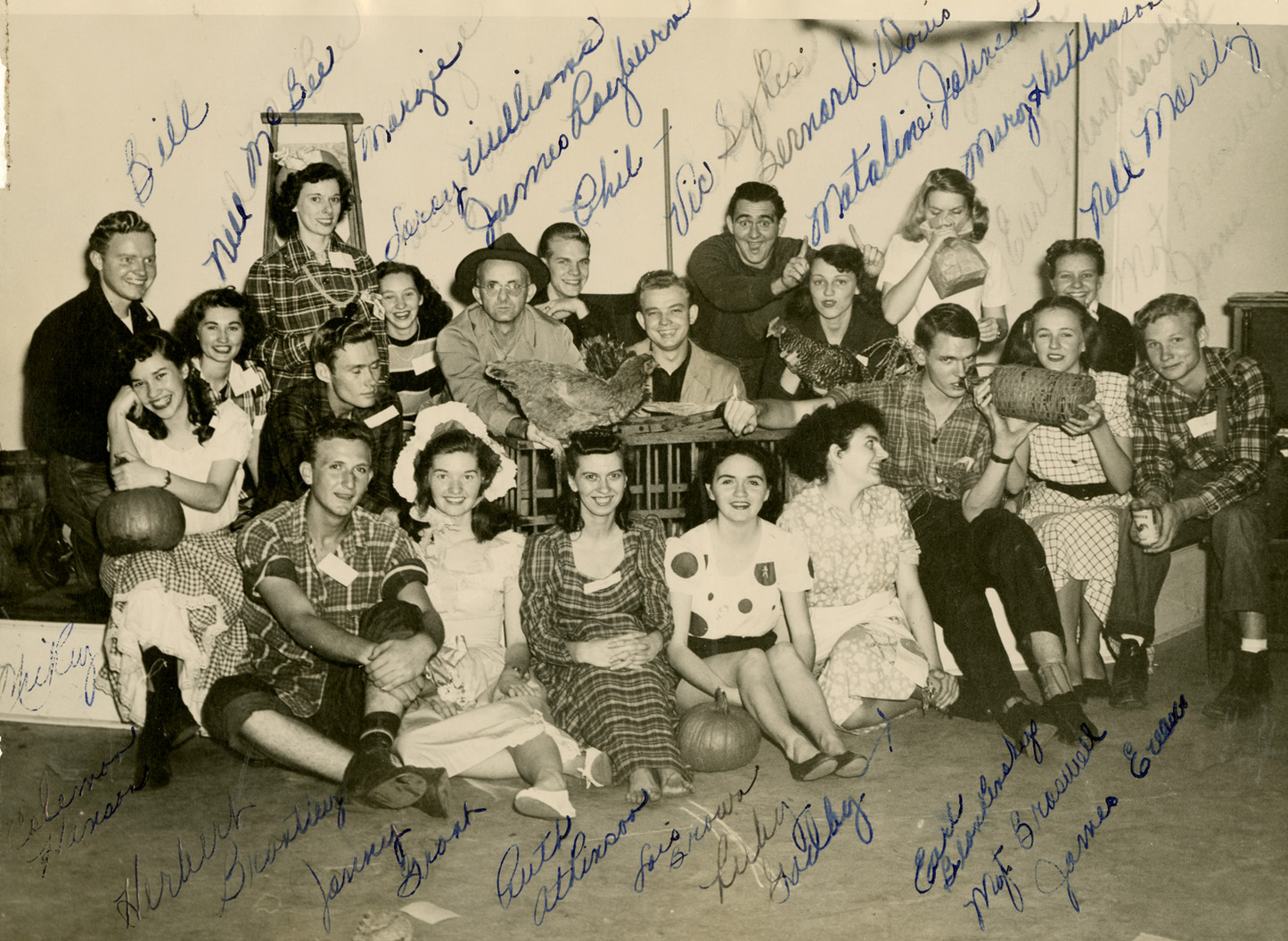 Costumed participants (and a chicken!) from the 1949 Watauga County Centennial posed for this image by local photographer Palmer Blair. Mickey McGuire is at far left with a pumpkin on her knee. Image courtesy of the Digital Watauga Project, Von and Mickey Hagaman Collection (Von-Hag-1-020).