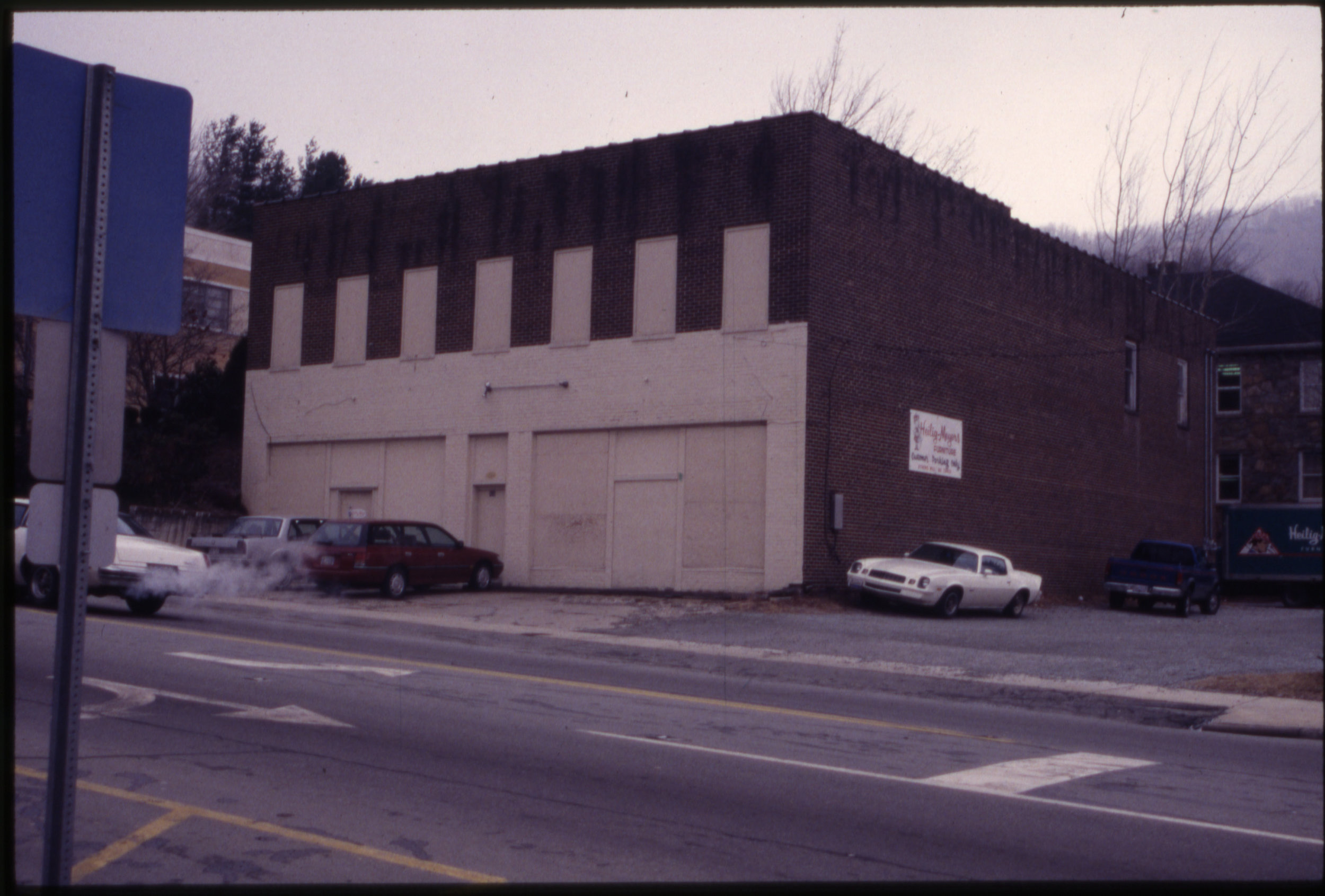 The former W. R. Winkler Warehouse/Masonic Hall (1949) is seen in this image as the Heilig-Meyers Warehouse during the 1990s. Most folks might think this building is gone, but in fact its walls served as the structure for the present Watauga County Administration Building. Image courtesy of the Downtown Boone Development Association Collection (Dow-Boo-1-007), Digital Watauga Project.