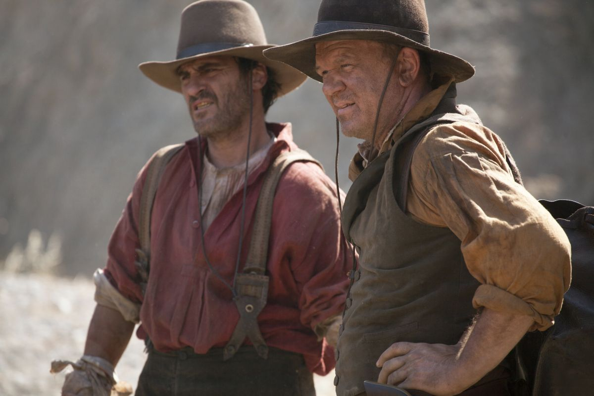 """Joaquin Phoenix (left) stars as """"Charlie Sisters"""" and John C. Reilly (right) stars as """"Eli Sisters"""" in Jacques Audiard's THE SISTERS BROTHERS, an Annapurna Pictures release.  Credit : Magali Bragard / Annapurna Pictures"""