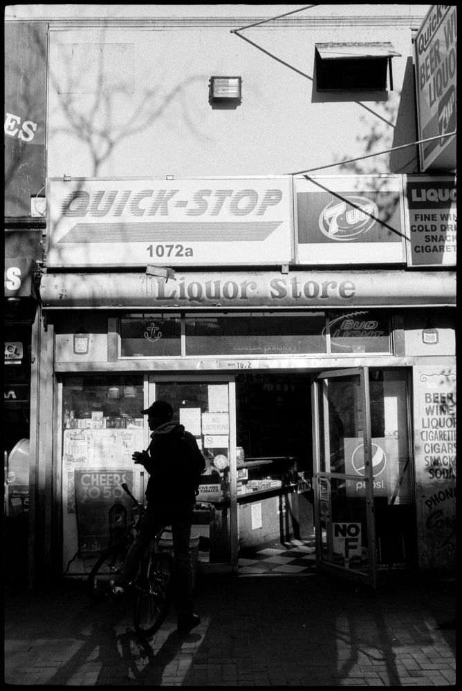#0435_28A - Liquor Store, Mid-Market Street. San Francisco, CA. March of 2016. Leica M2, Zeiss 35mm f/2, Ilford HP5 400.