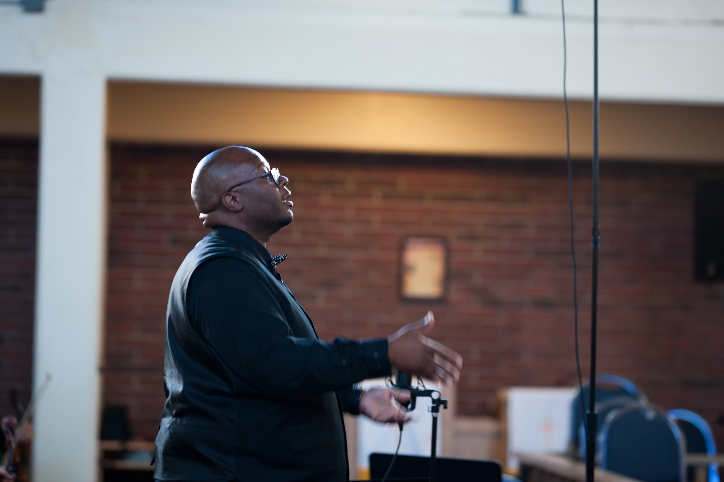 Derrick McDuffey conducts professional gospel ensemble, Kingdom Sound. — October 2018 ( Photo Credit: Rachel Hadiashar)