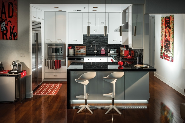 """""""Joshua Allen of Orlando's AA Tile & Stone installed new black granite countertops and created a """"waterfall"""" look by extending the granite vertically at the end of the counter. The effect contributed to the kitchen's overall contemporary Poggenpohl look.""""     -Orlando Magazine, October 2016"""