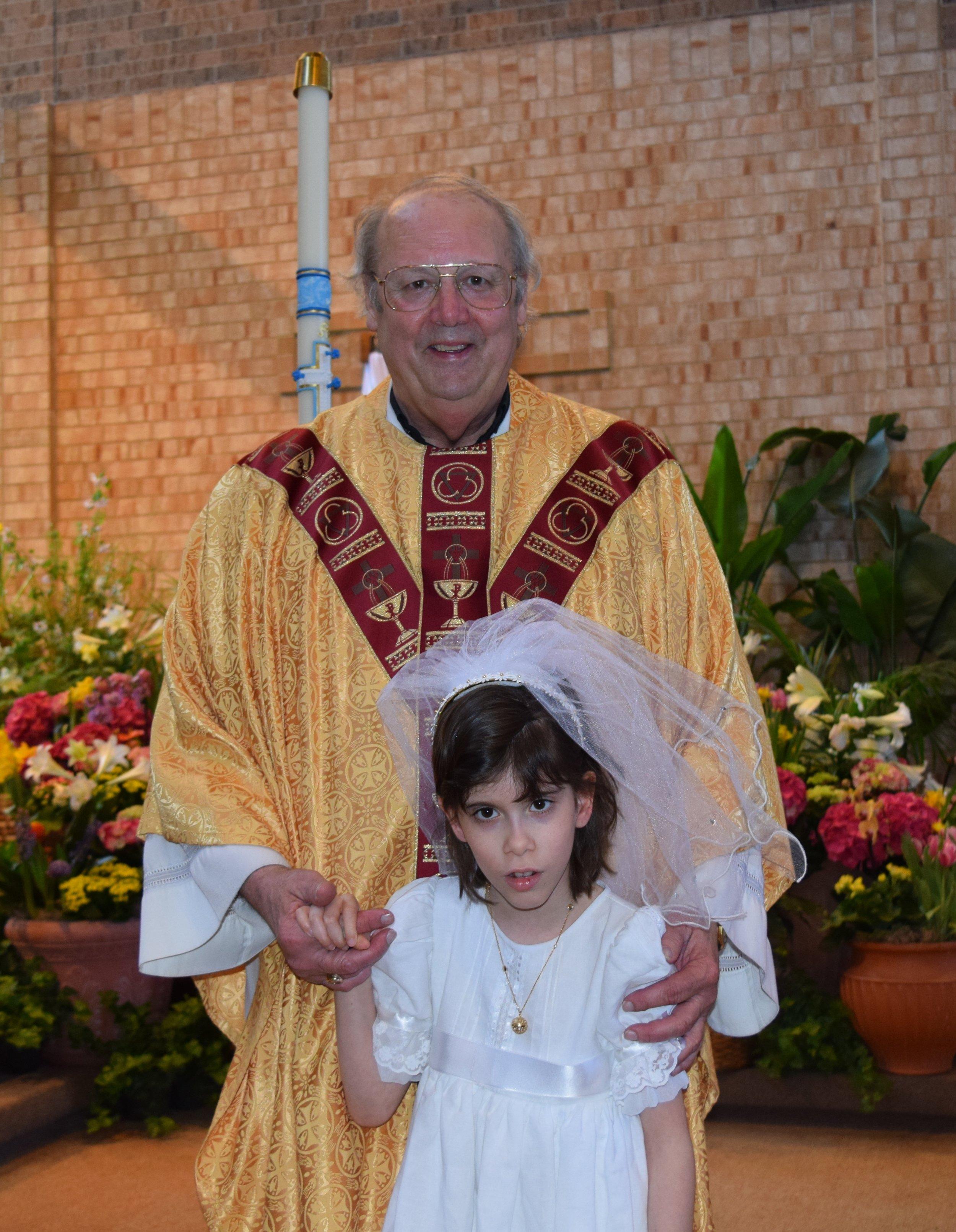 Fr Ryan and Natalia 1st communion 2.jpeg