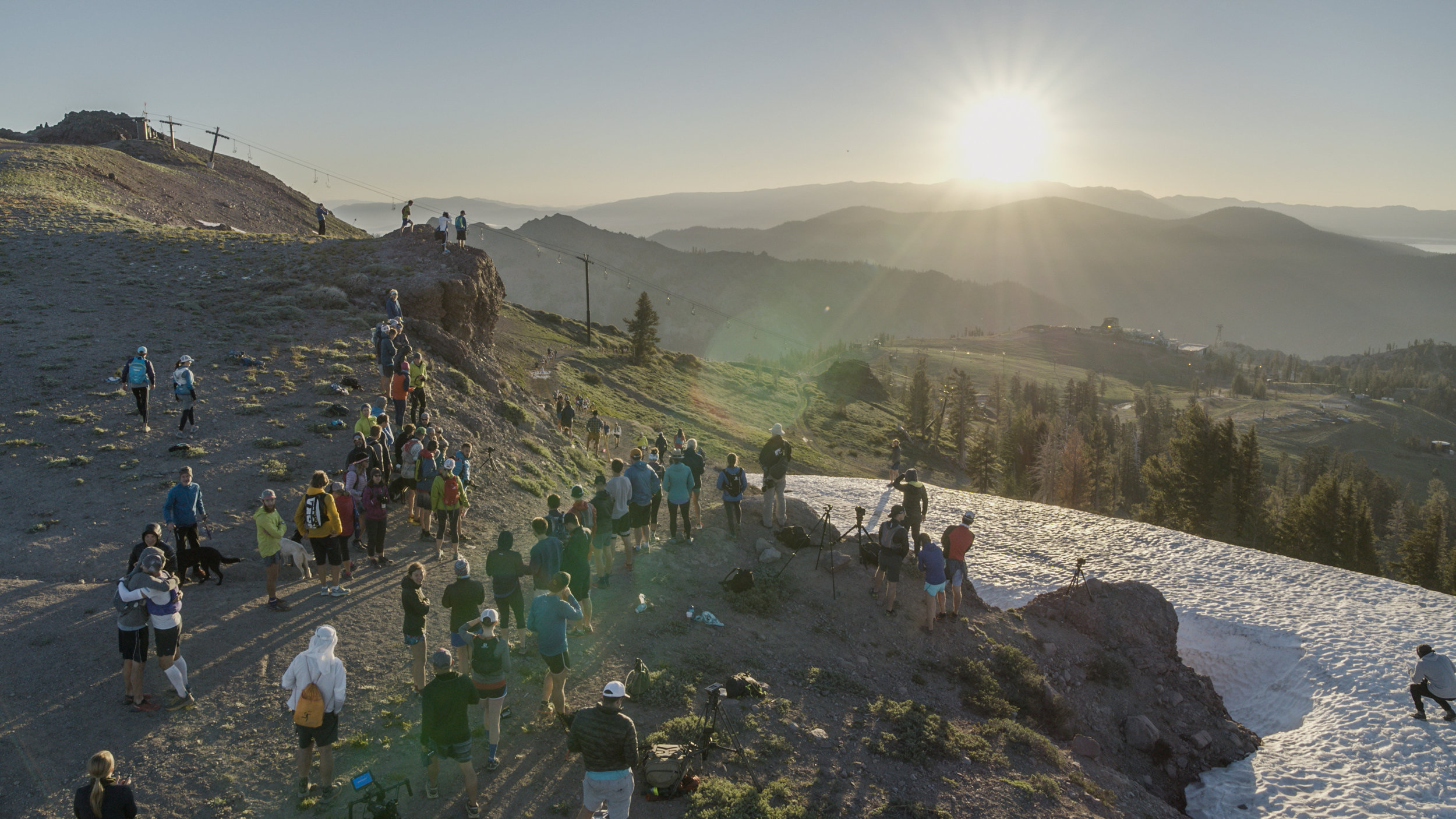 Runners crest the top of the escarpment at Squaw Valley just after sunrise. They have completed 3 of 100 miles. Squaw Valley, California.