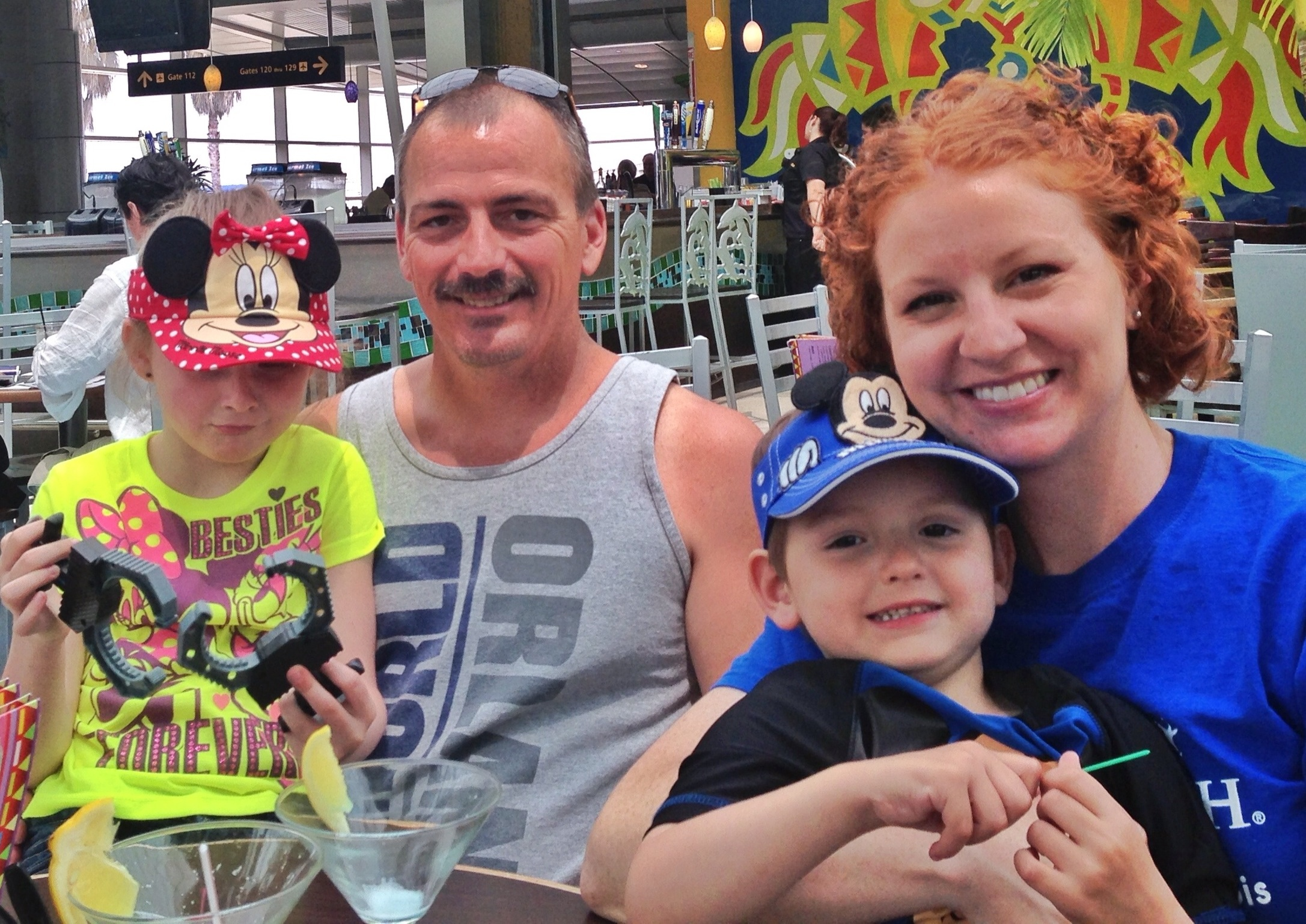The Howard family - dad Jim, mom Lacey and their kids Finley, left, and Landon - spent a week in Orlando through Give Kids the World
