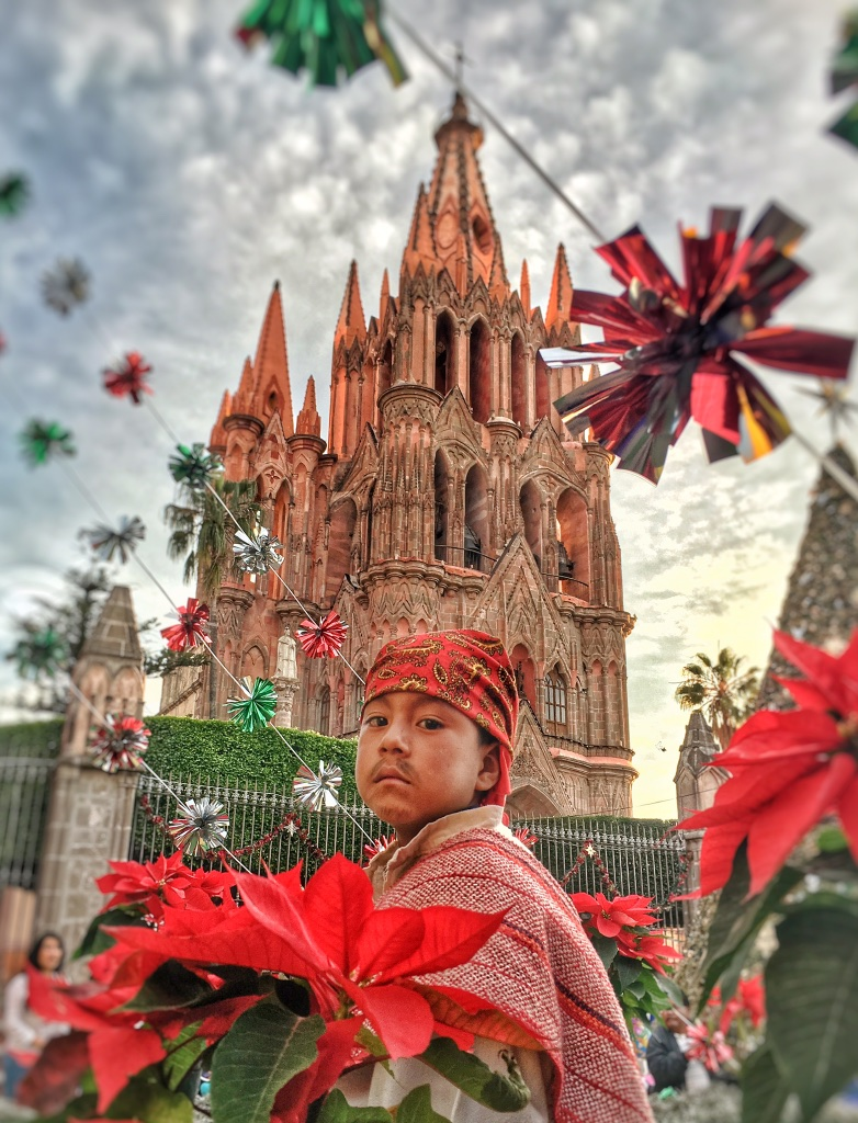 A young Joseph readies for a posada procession in front of San Miguel's Parroquia