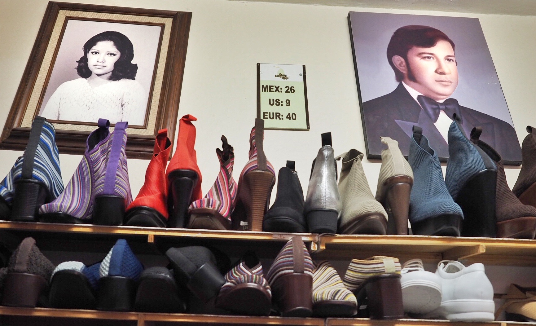 A young Marta and Santiago, founders of San Miguel Shoes, watch over their wares in the original shop on Relox Street.