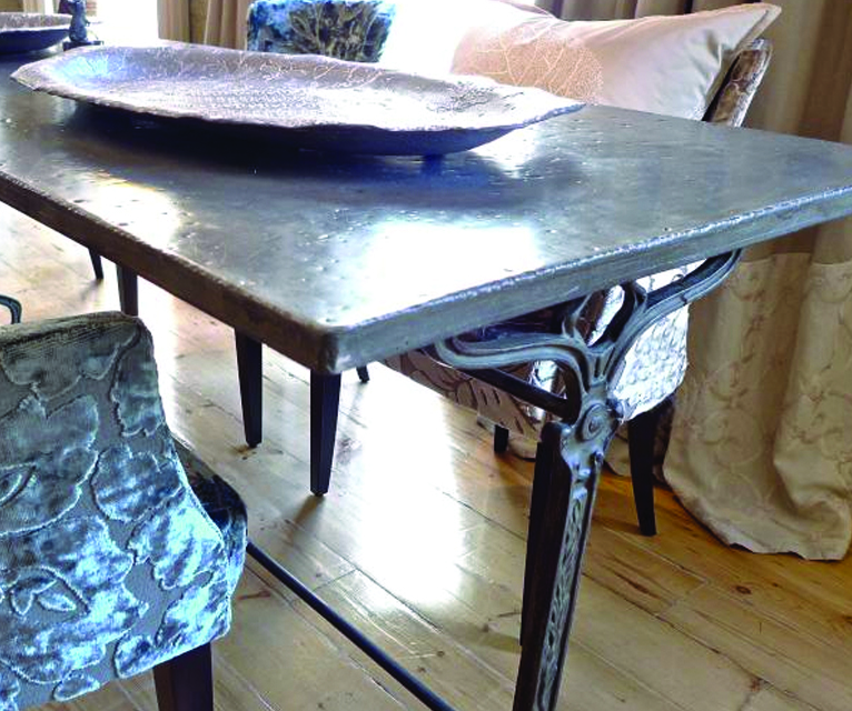 WE IMPORT   AND ALSO CUSTOM BUILD TABLES USING UNUSUAL ARCHITECTURAL ELEMENTS FROM EUROPE