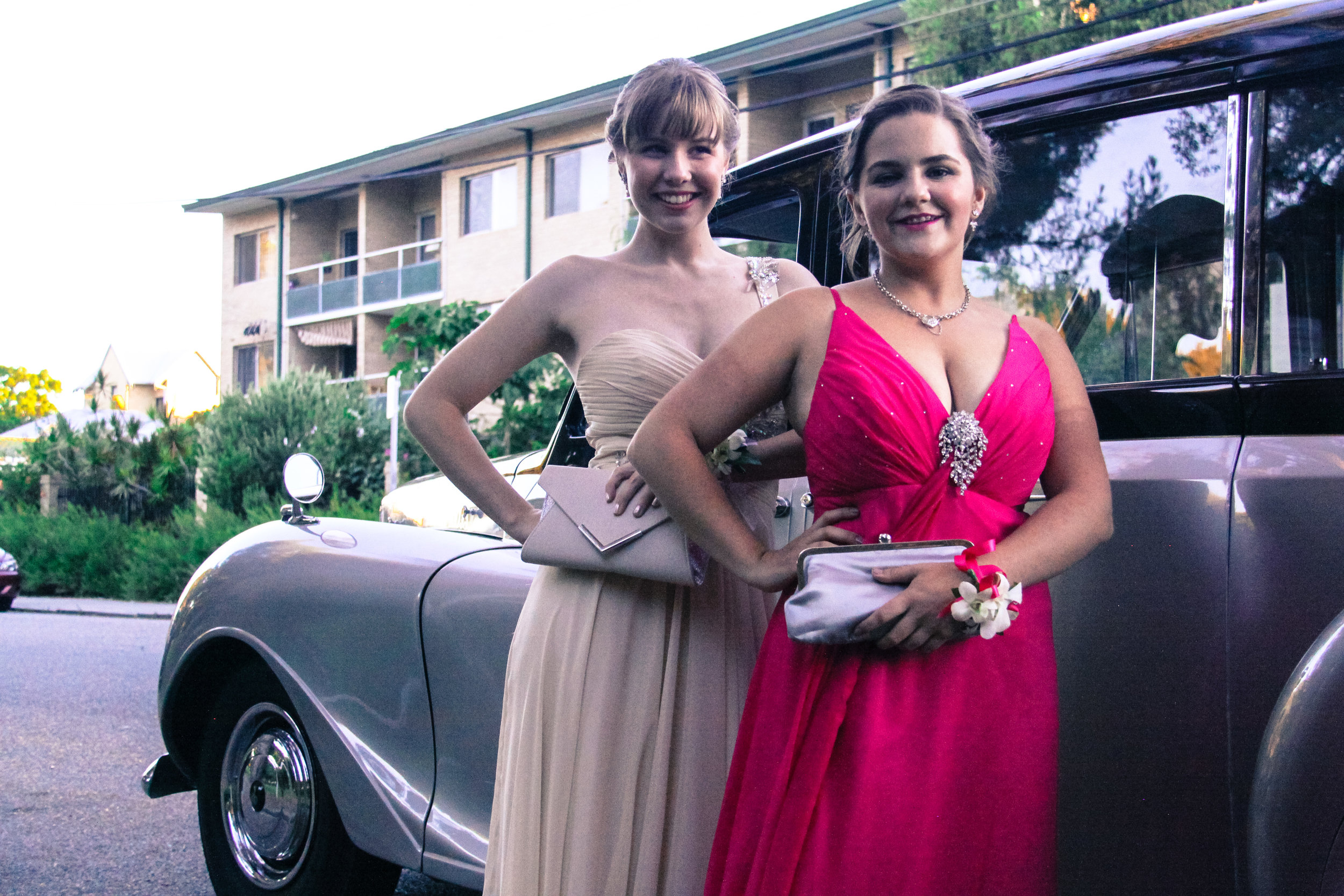 two-girls-with-very-nice-classics-wedding-cars-school-balls-perth.jpg