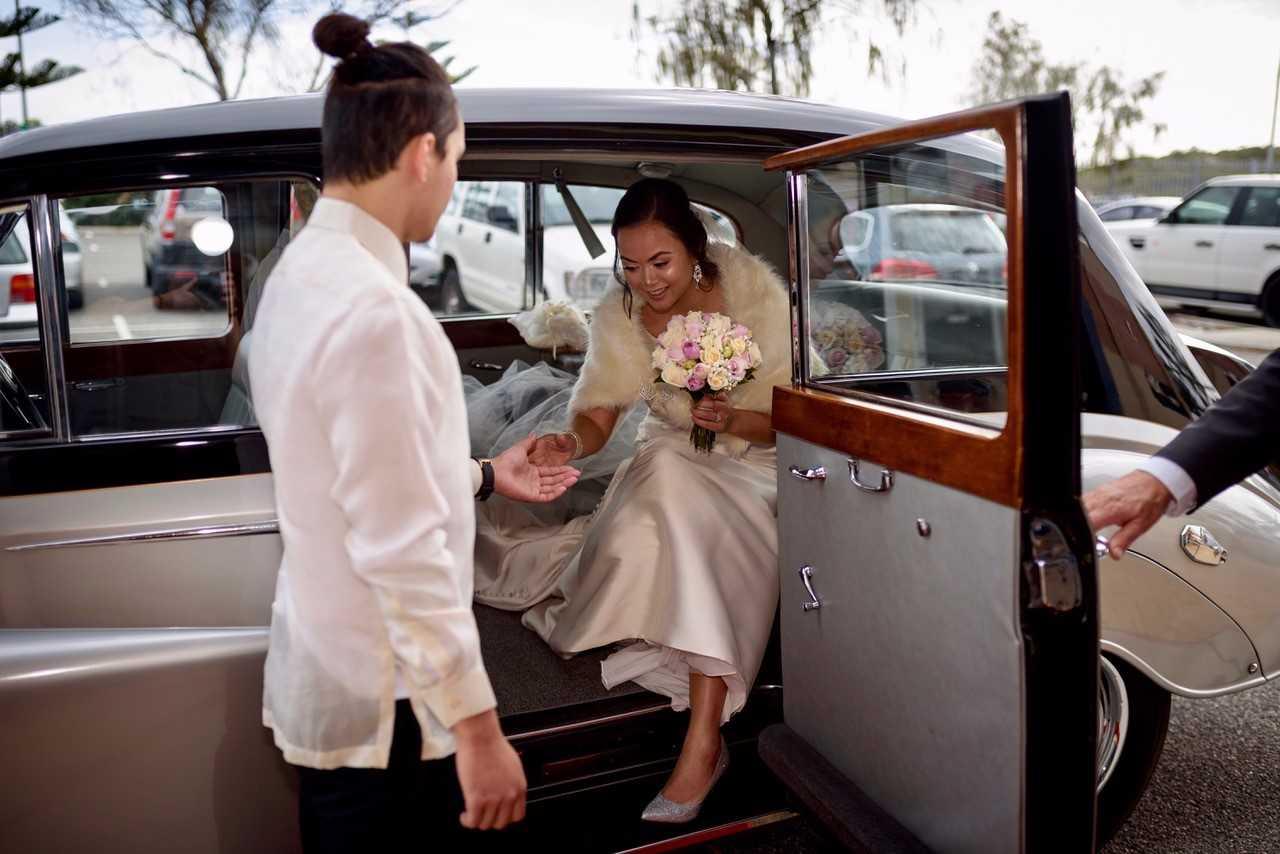 36-marie-exiting-very-nice-classics-wedding-cars-perth.jpg