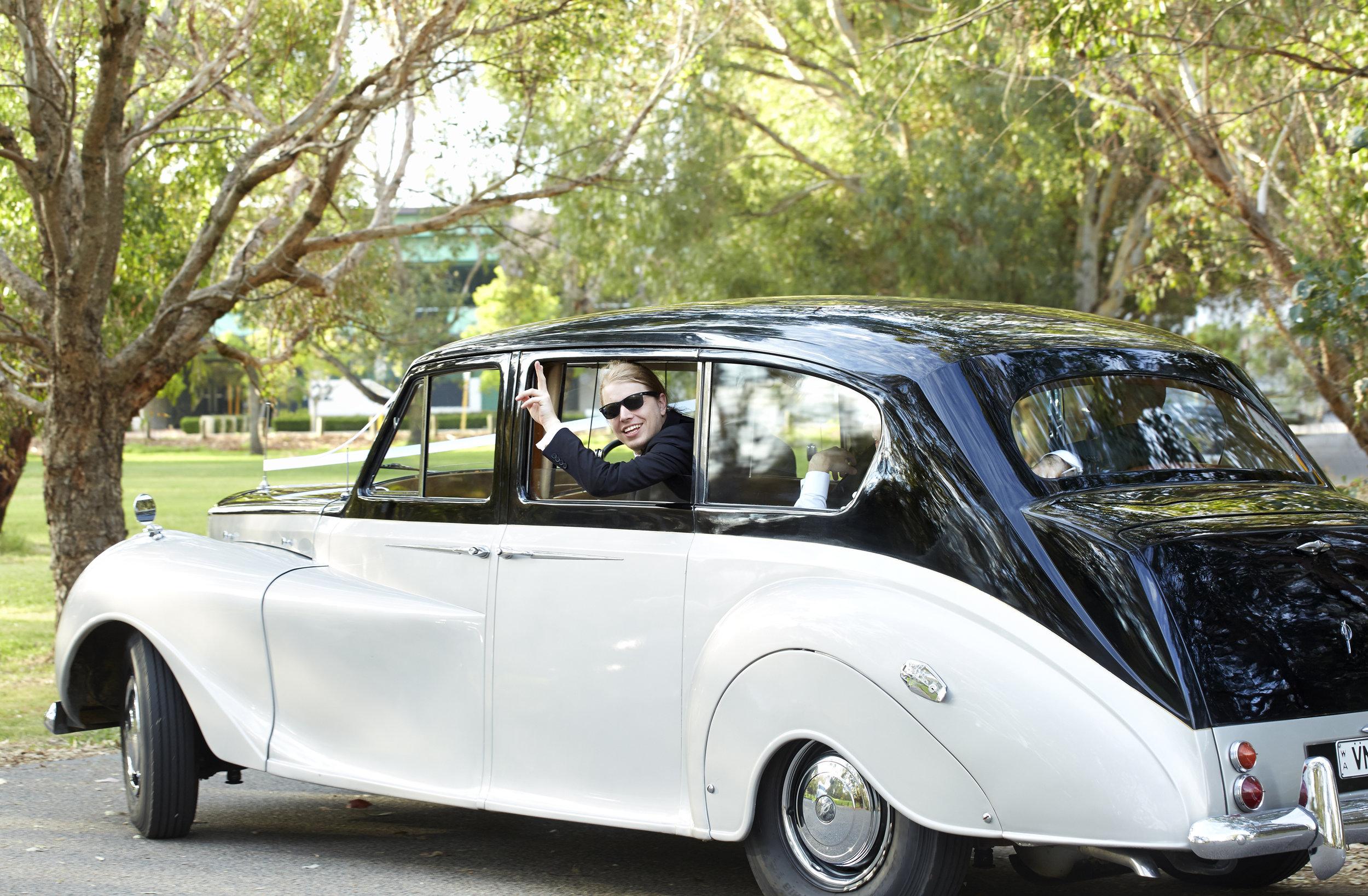 25-groomsman-waving-from-wedding-car-window-in-perth-very-nice-classics.jpeg