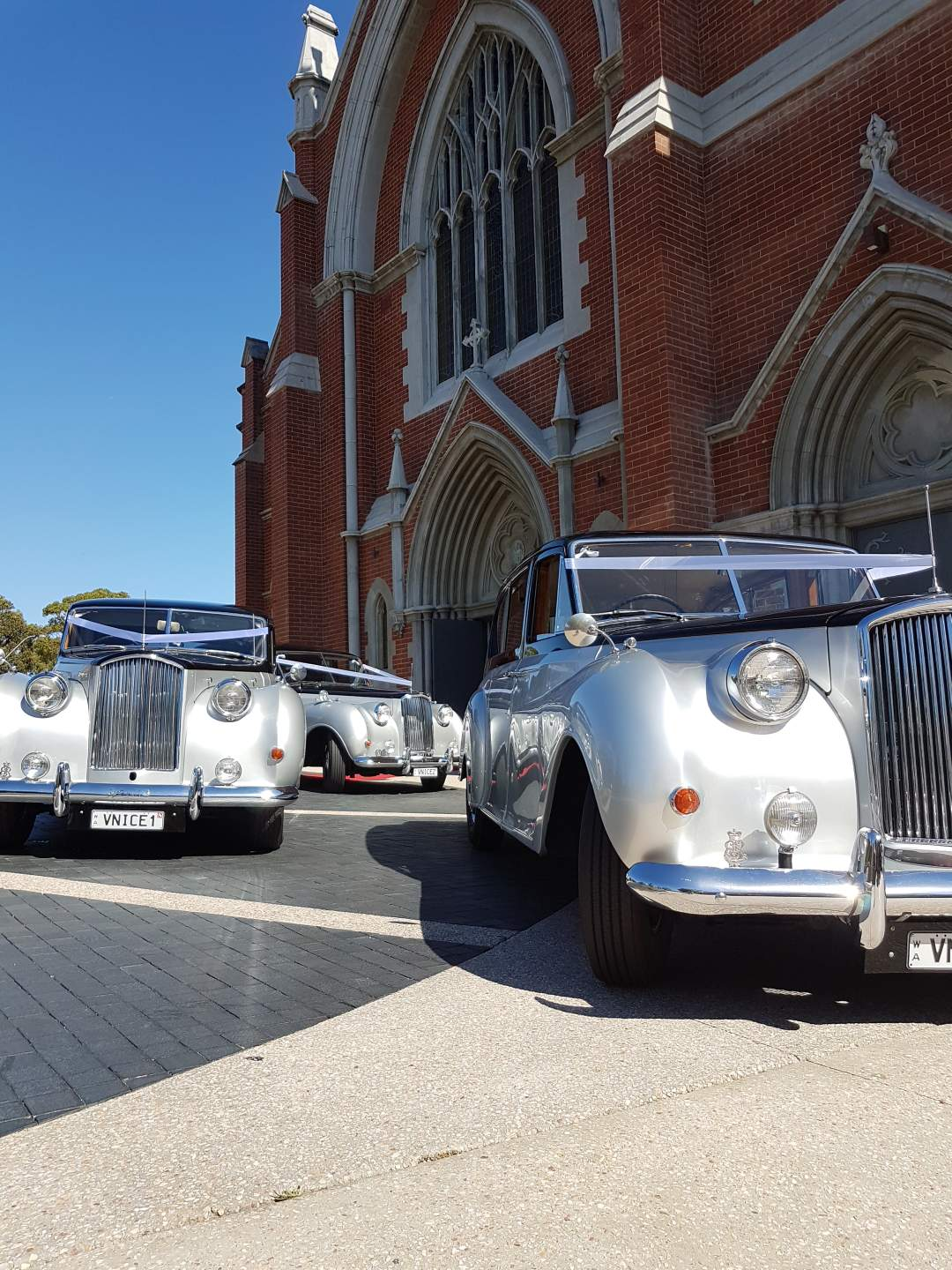 3-very-nice-classics-wedding-cars-in-perth-in-front-of-church.jpeg